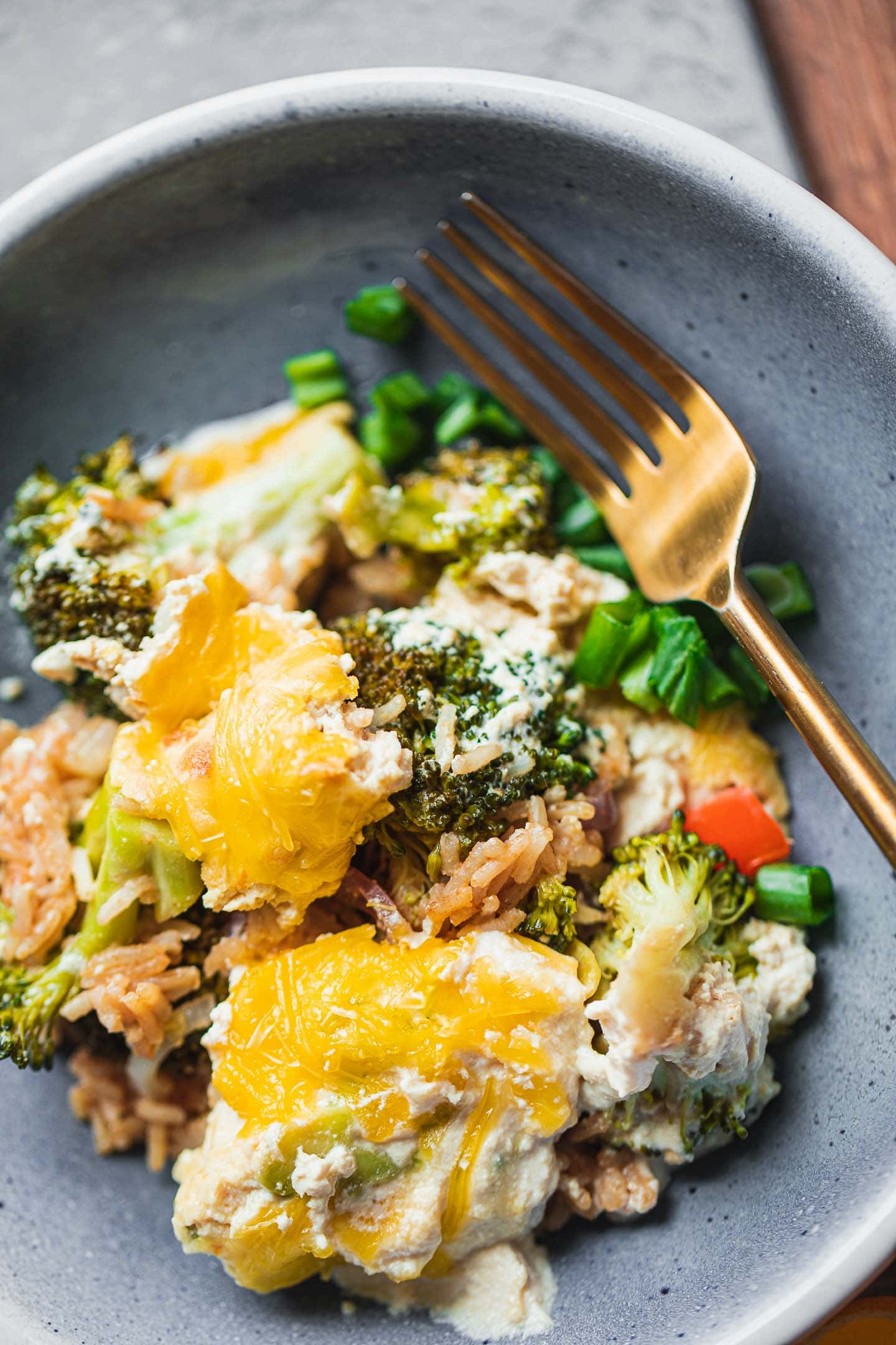 Blue bowl with vegan broccoli casserole