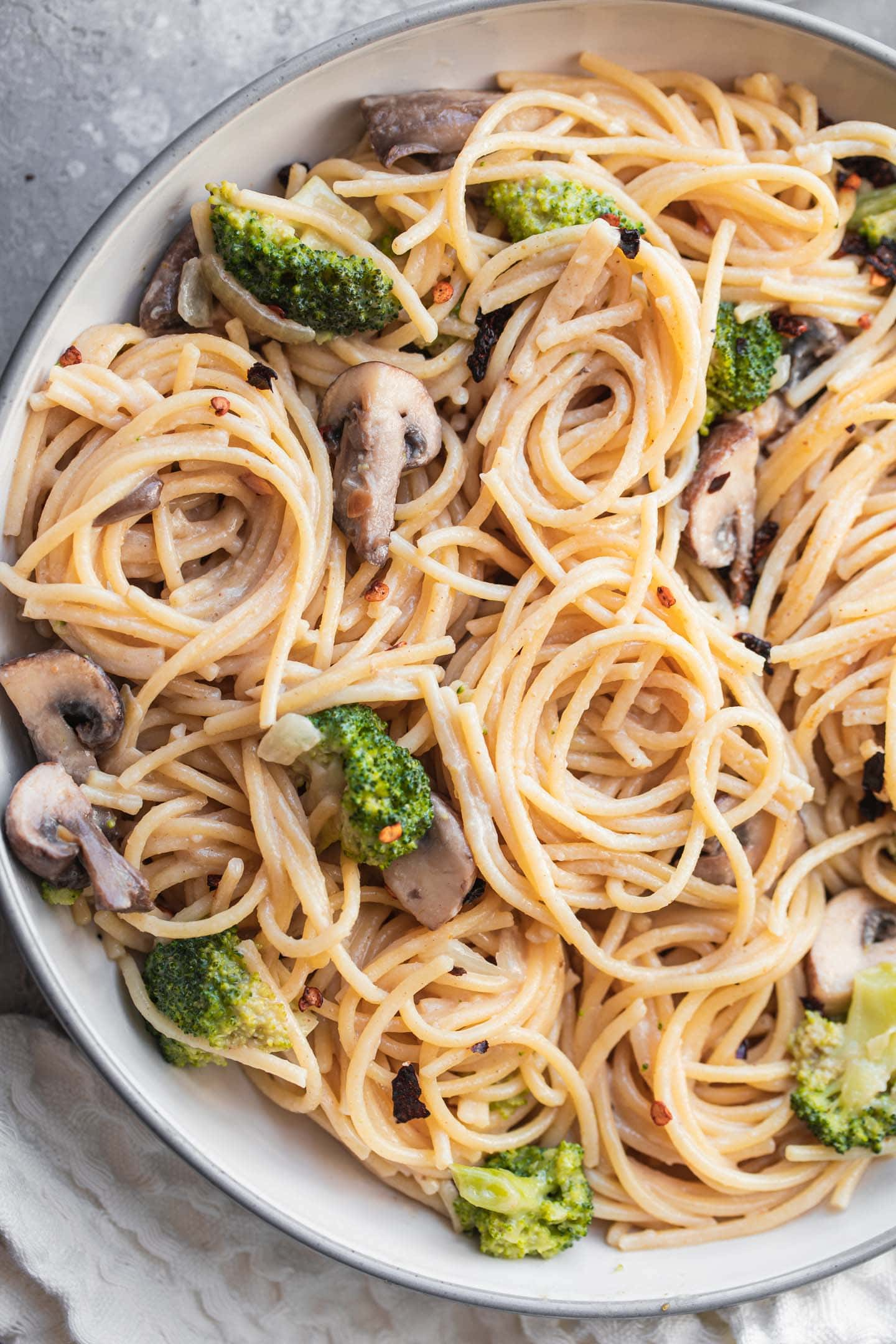 Bowl of coconut pasta with broccoli