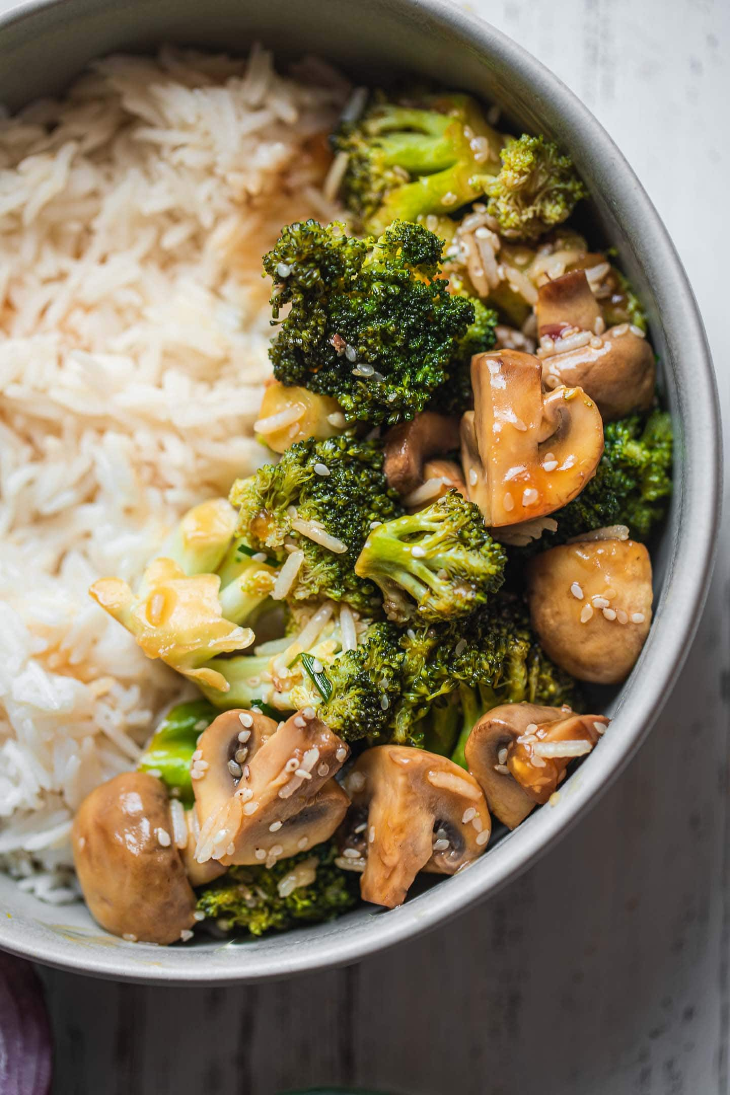Closeup of vegan broccoli stir fry with rice
