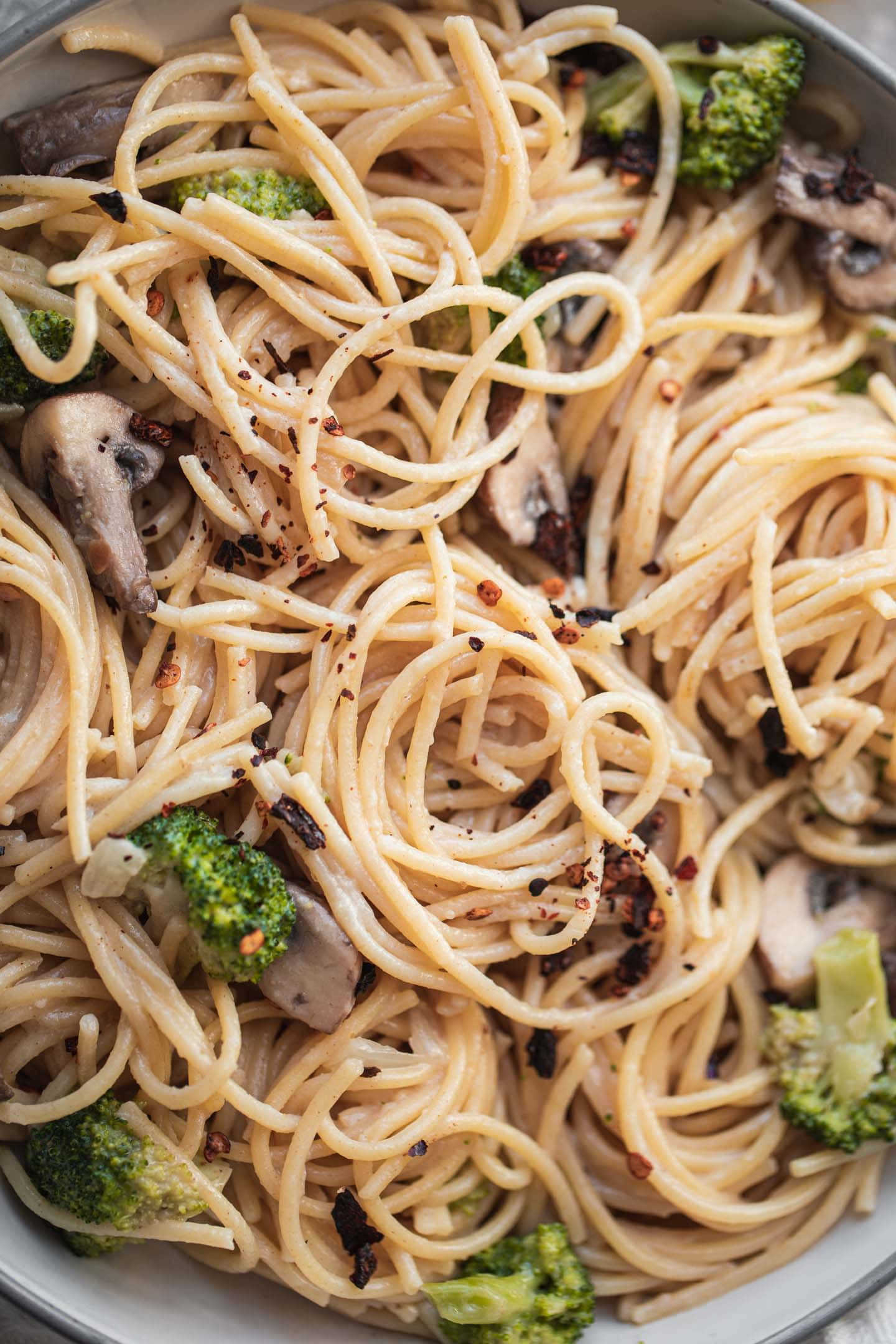 Coconut pasta bowl with broccoli and mushrooms