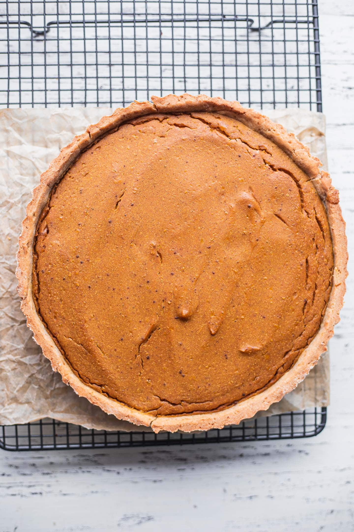 Dairy-free pumpkin pie on a cooling rack