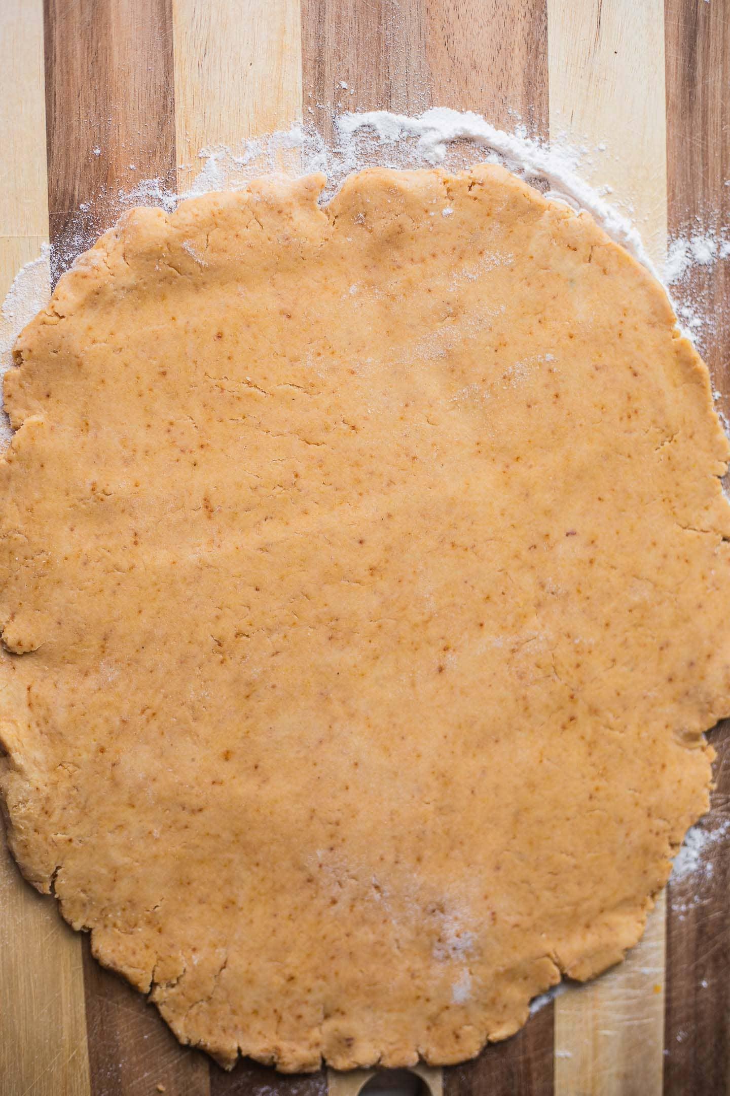 Pie crust dough on a wooden board