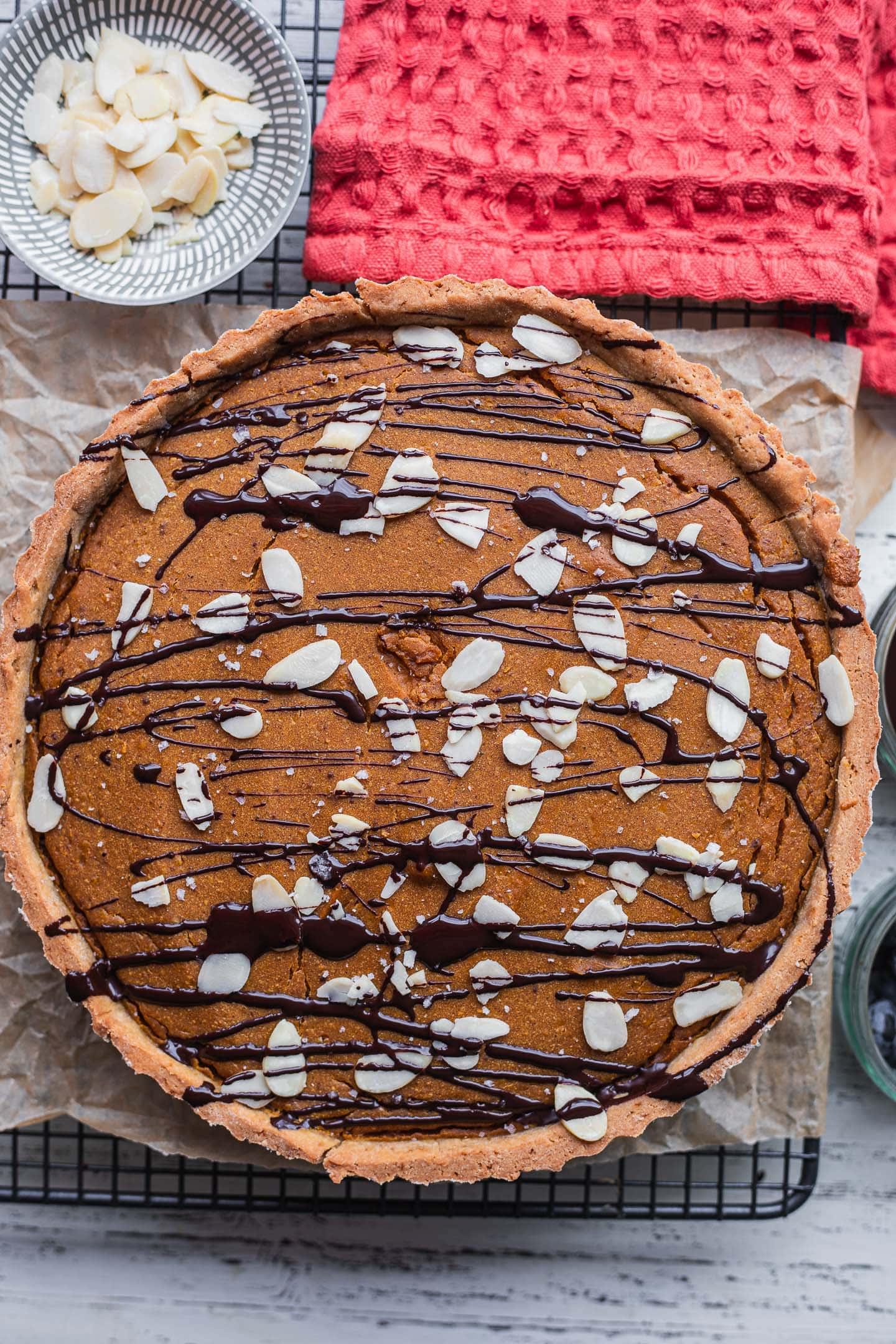 Vegan pumpkin pie on a cooling rack