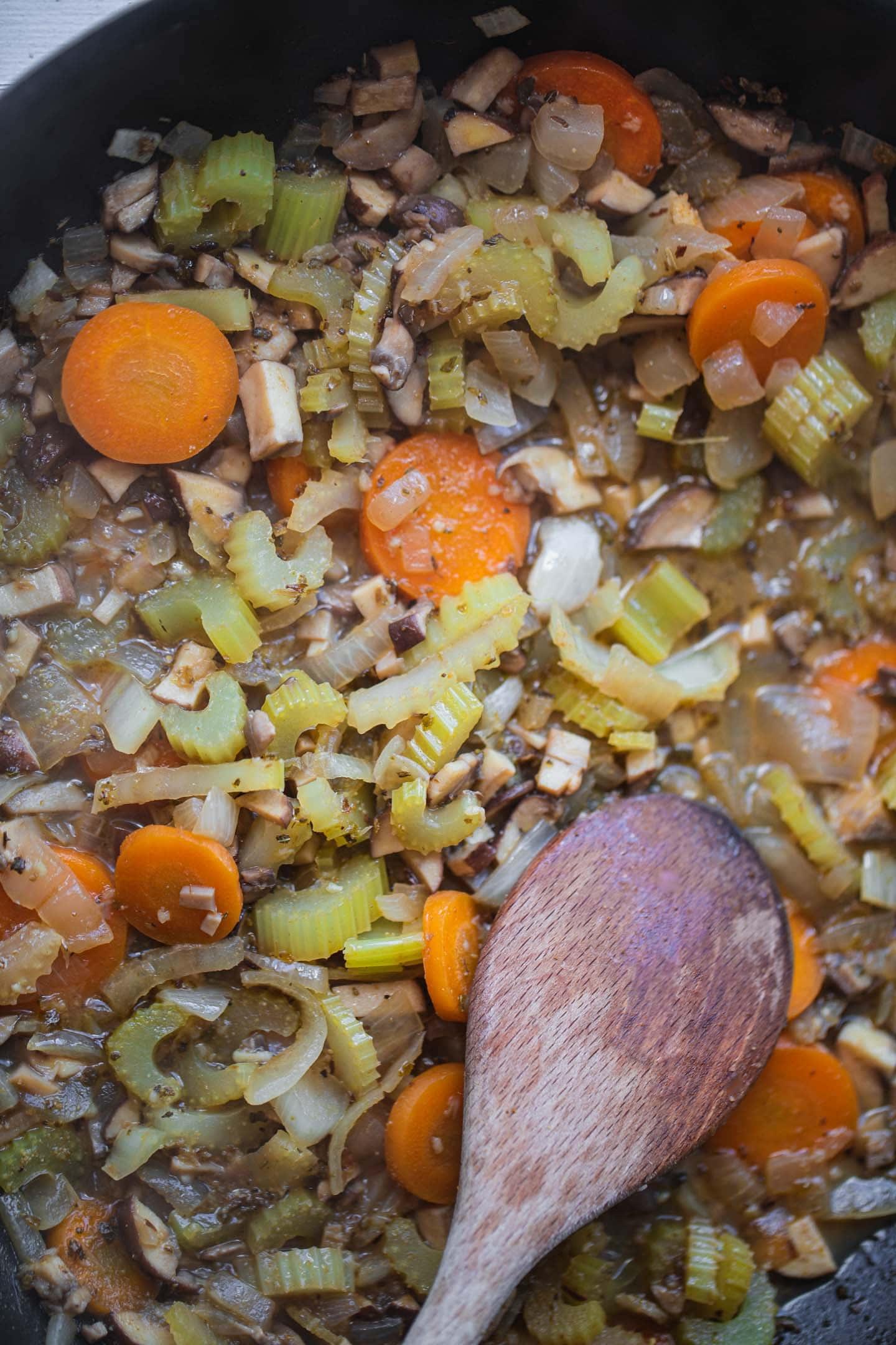 Vegetables in vegetable broth in a frying pan