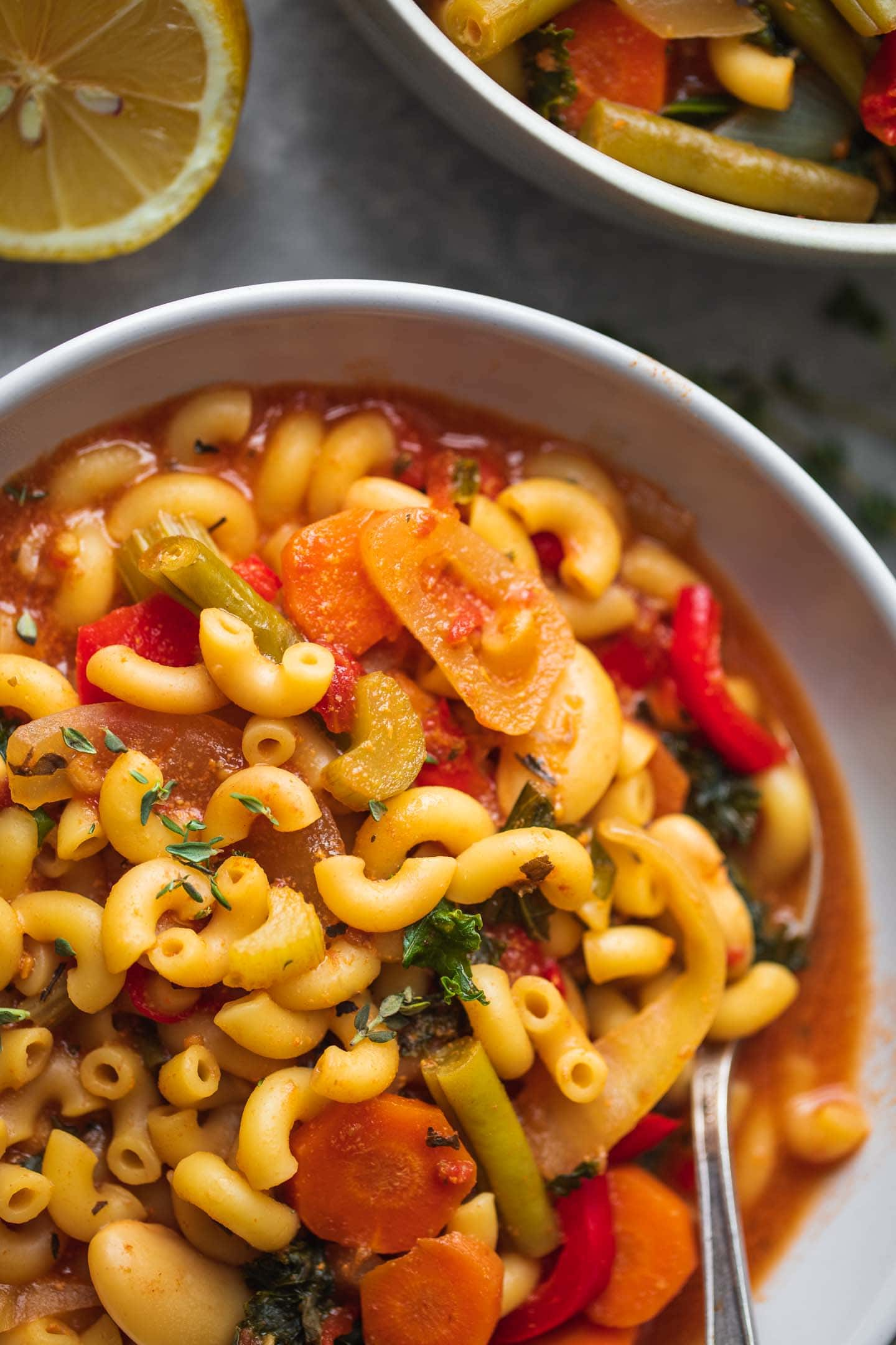 Bowl of vegetable soup with pasta and butter beans