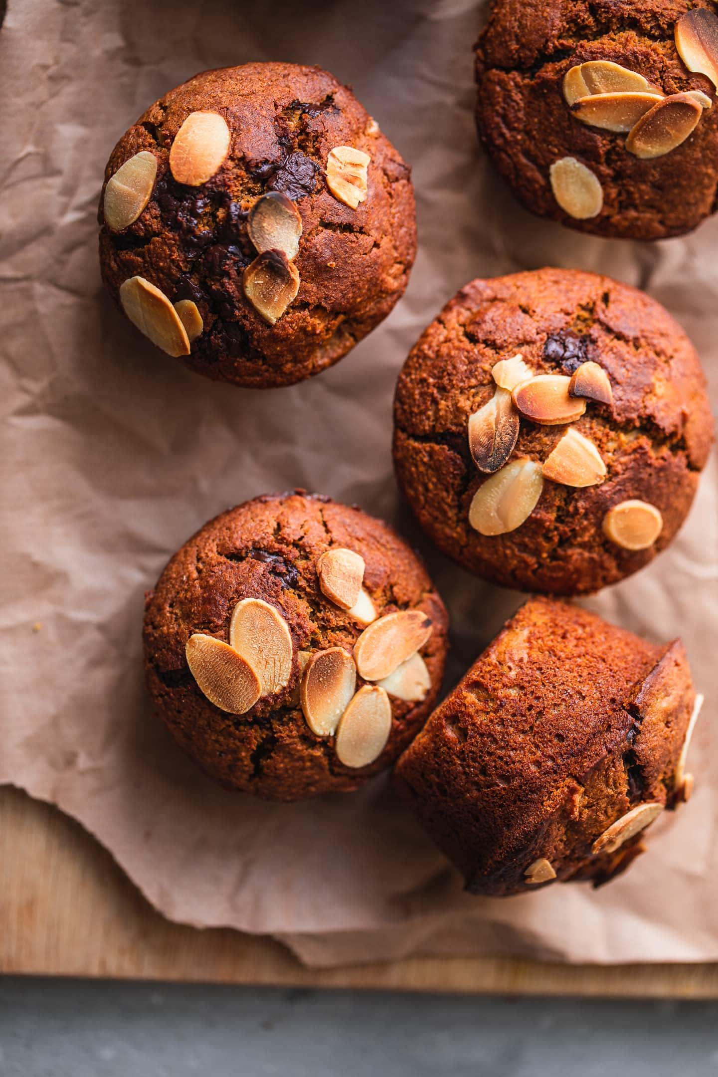 Closeup of muffins with almonds on a wooden board