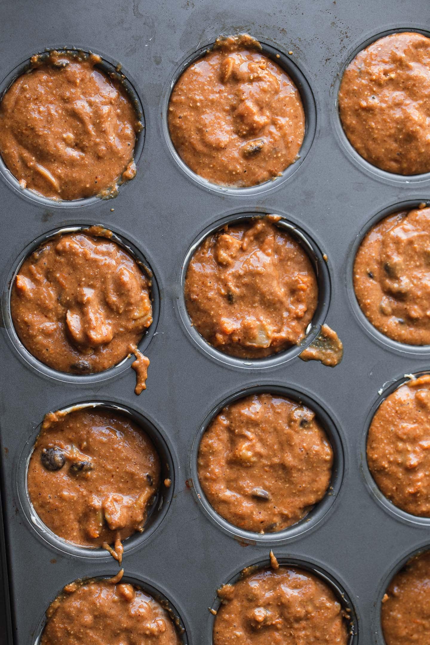 Pumpkin muffin batter in a muffin tray