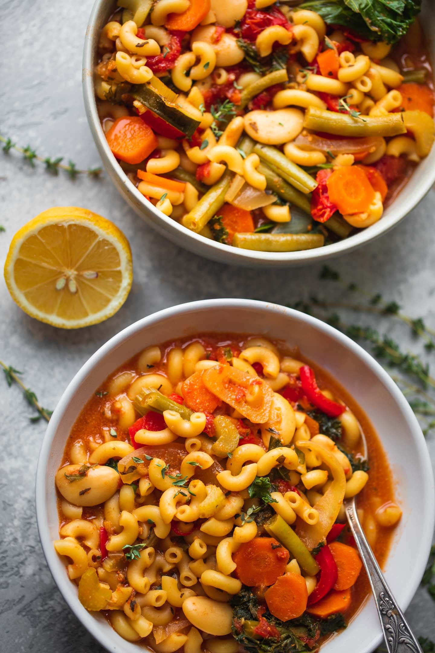 Two bowls of minestrone soup with beans and pasta
