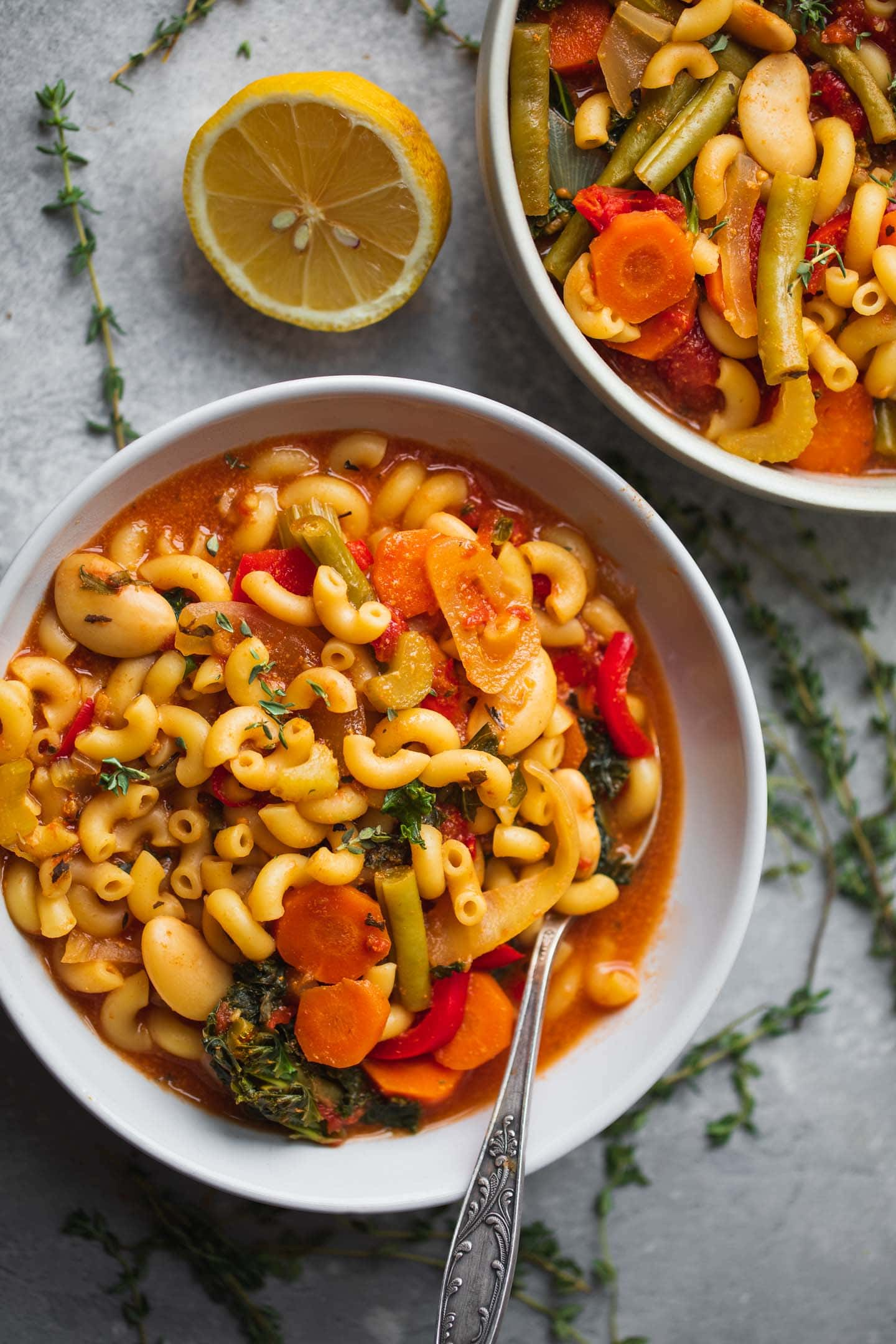 Vegan minestrone soup with macaroni and butter beans