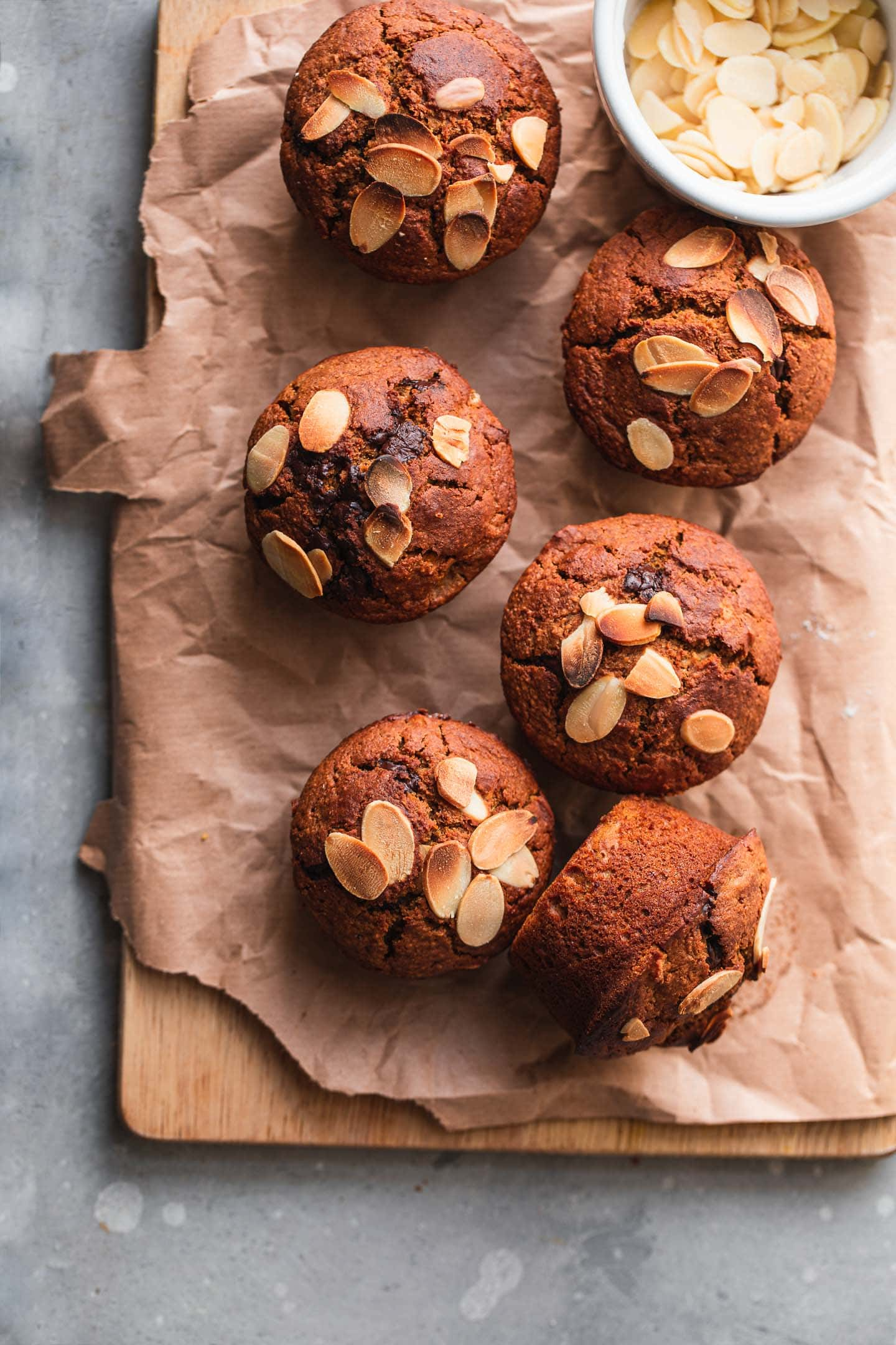 Vegan muffins with almonds on a wooden board