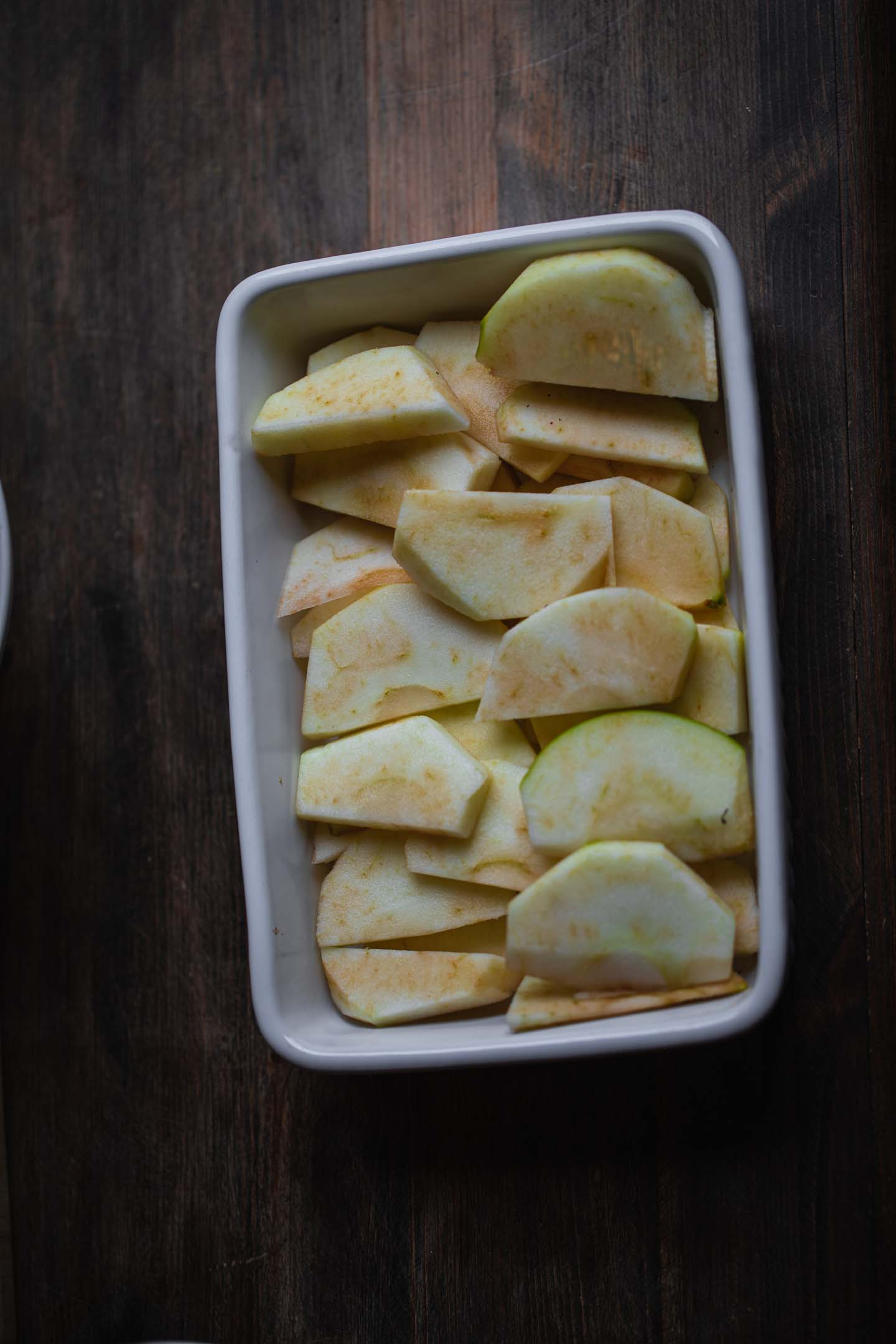 Apple slices in a baking dish