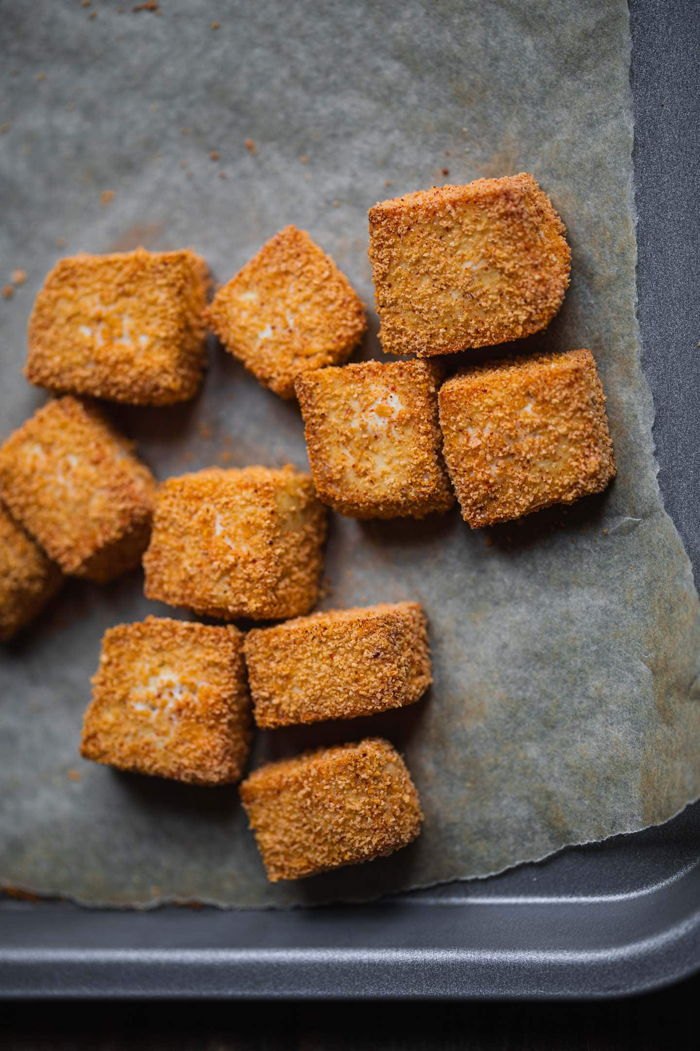 Baked crispy tofu on a baking tray