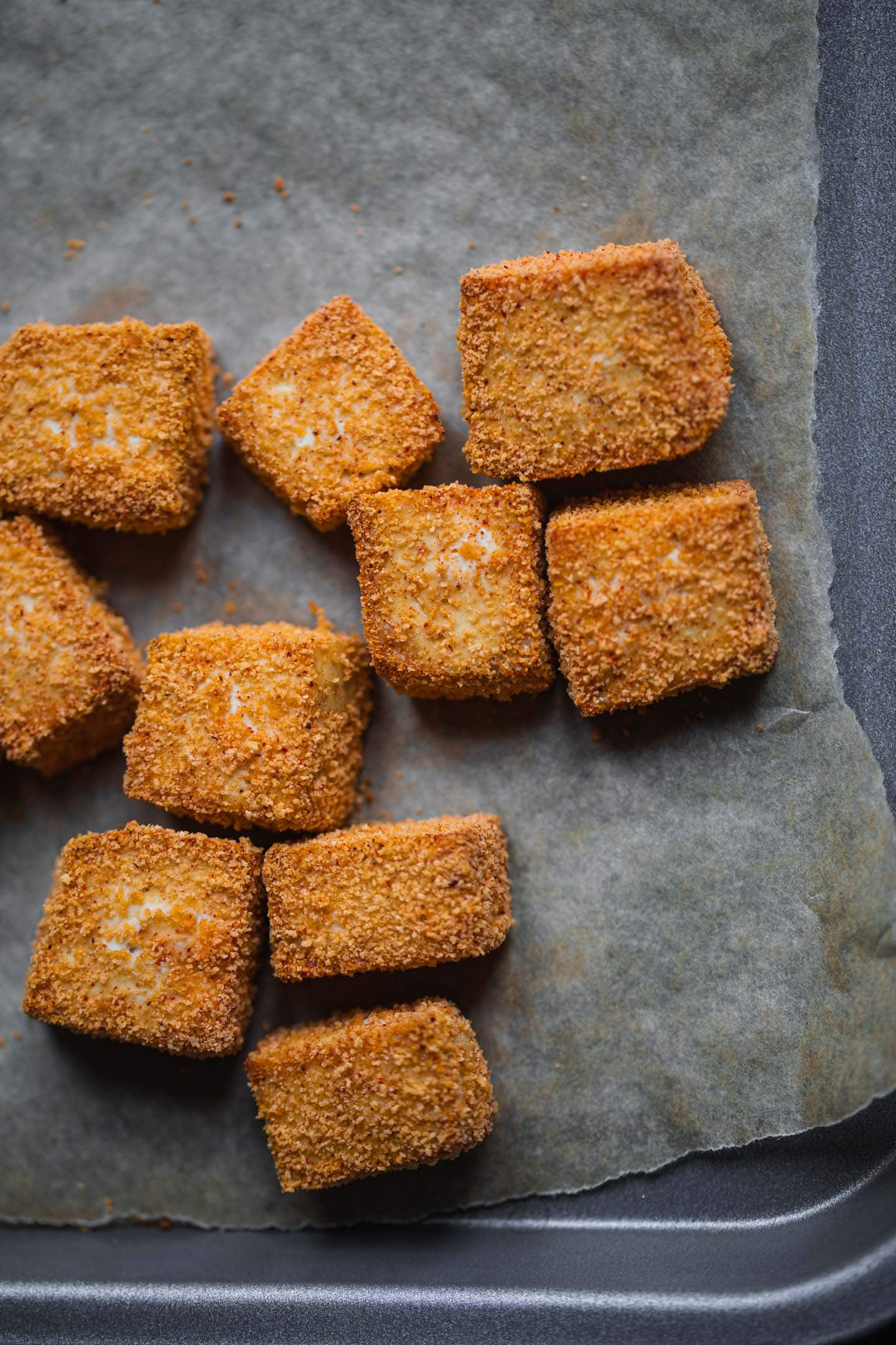 Baked tofu cubes on a baking tray