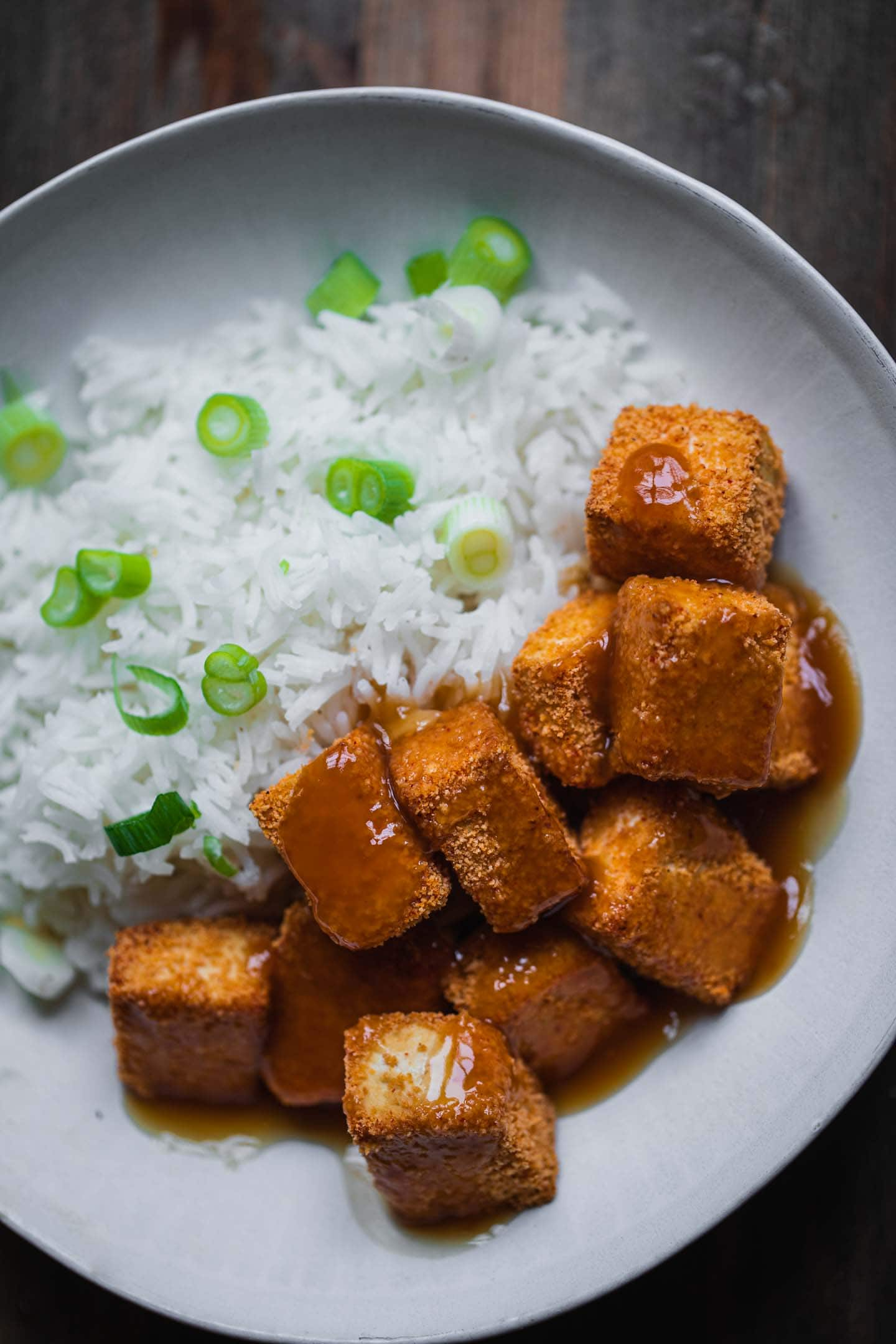 Baked tofu cubes with rice and sweet and sour sauce