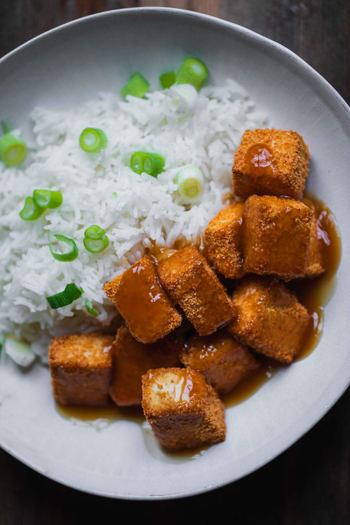 Crispy baked tofu with rice and a sweet and sour sauce