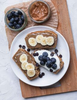Vegan pecan bread slices with banana and blueberries
