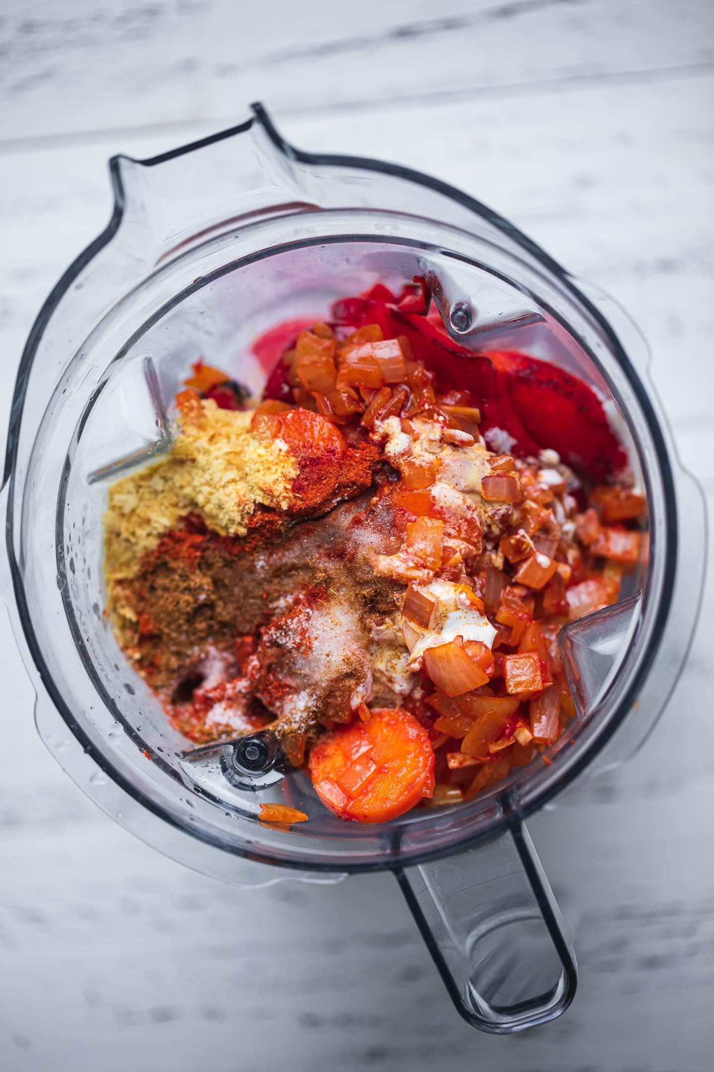 Vegan tomato bisque ingredients in a blender