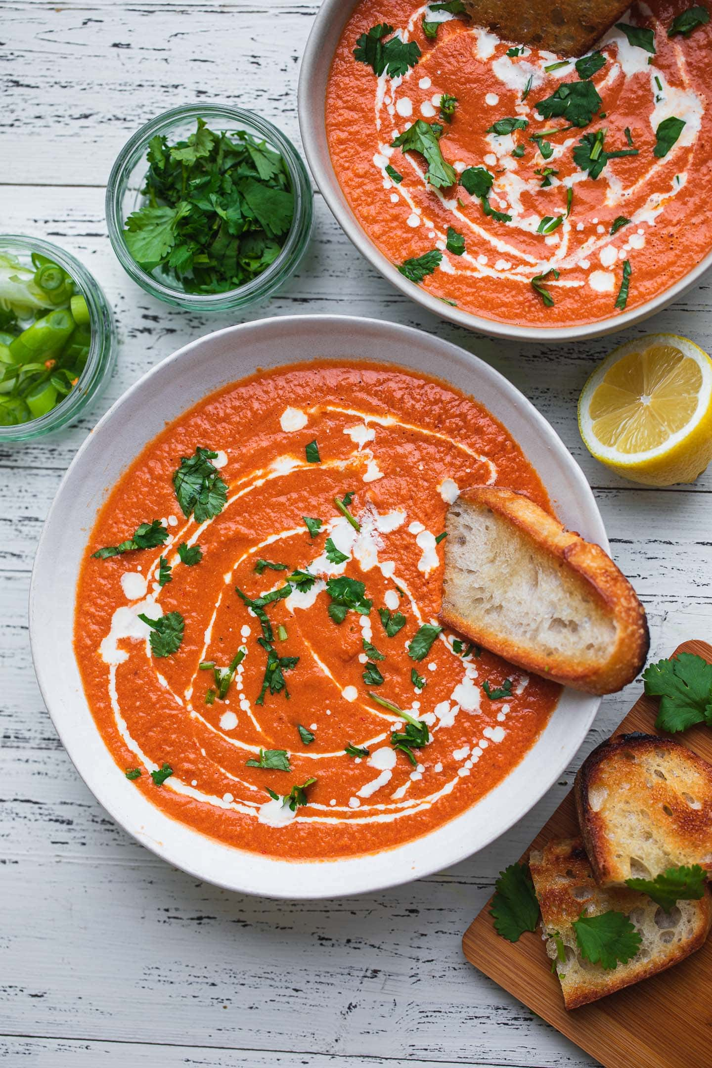 Vegan tomato bisque with bread and herbs