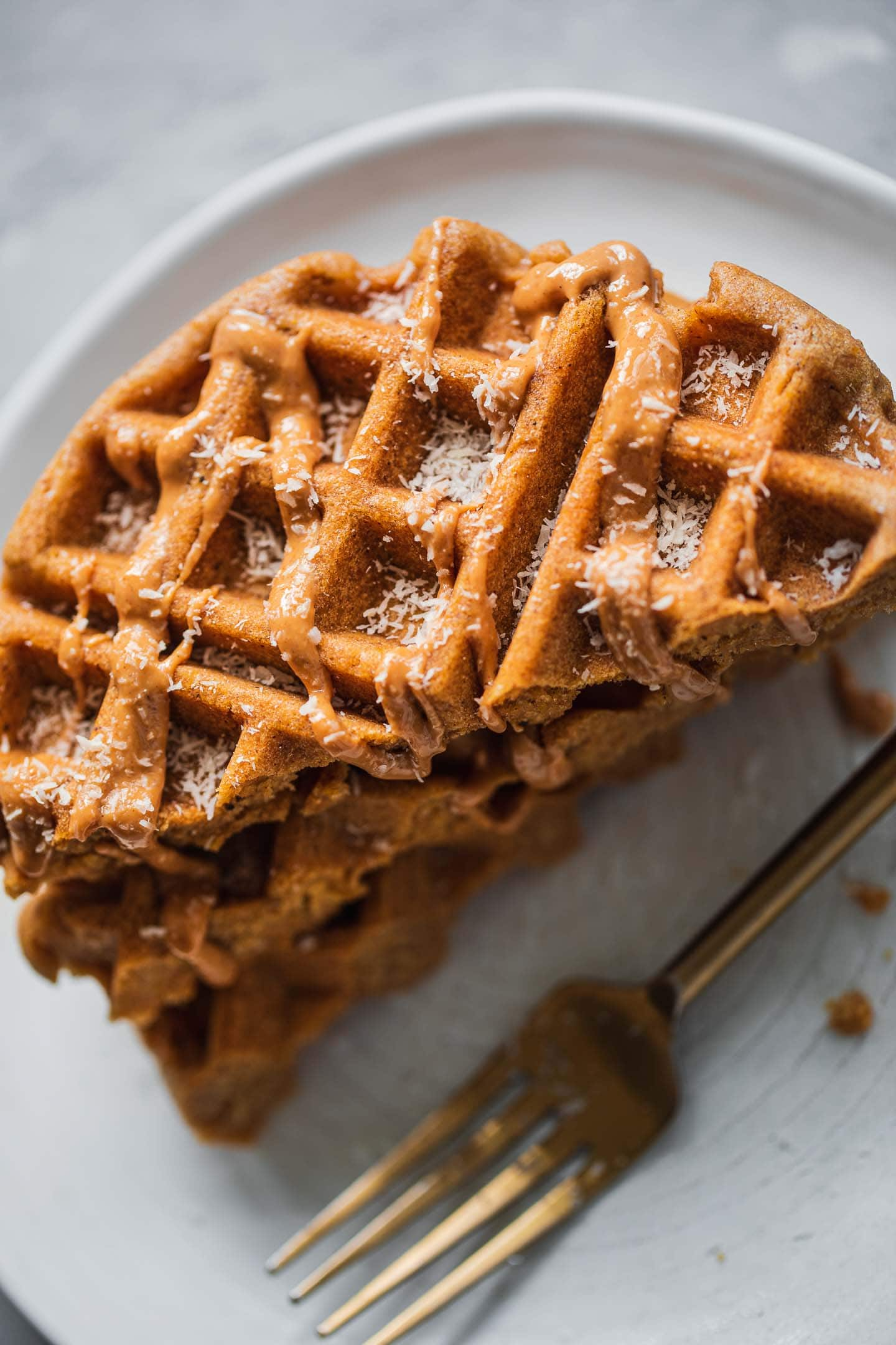 Gingerbread waffles with a drizzle of peanut butter