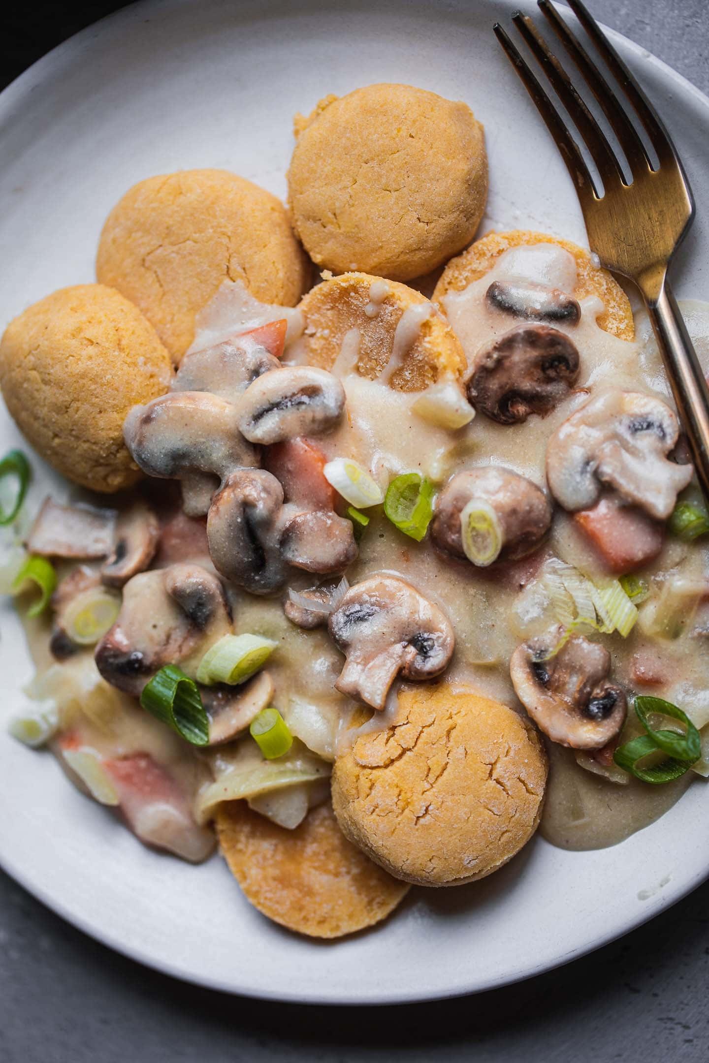 Plate of gluten-free vegan biscuits with mushroom gravy