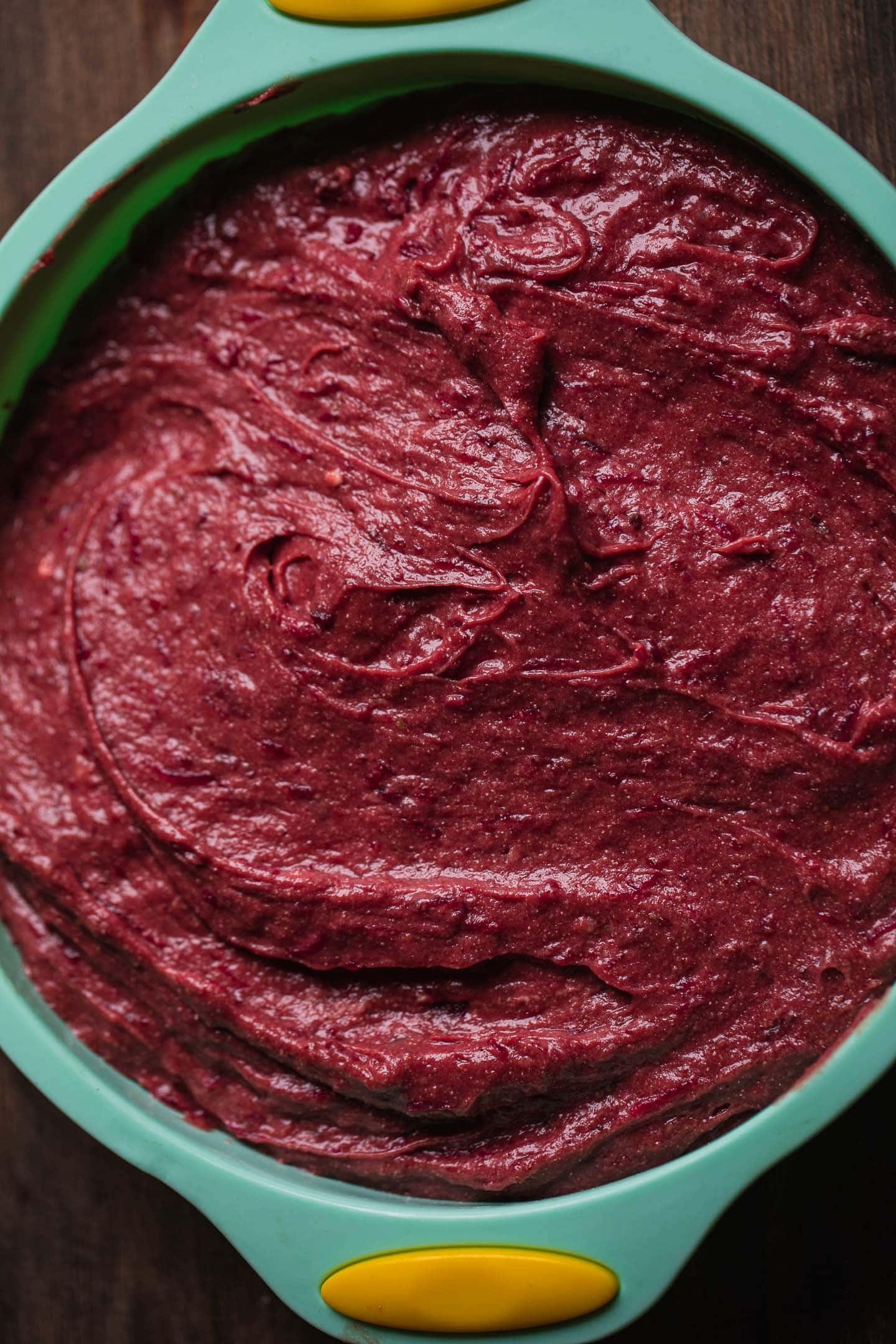 Red velvet cake batter in a cake tin