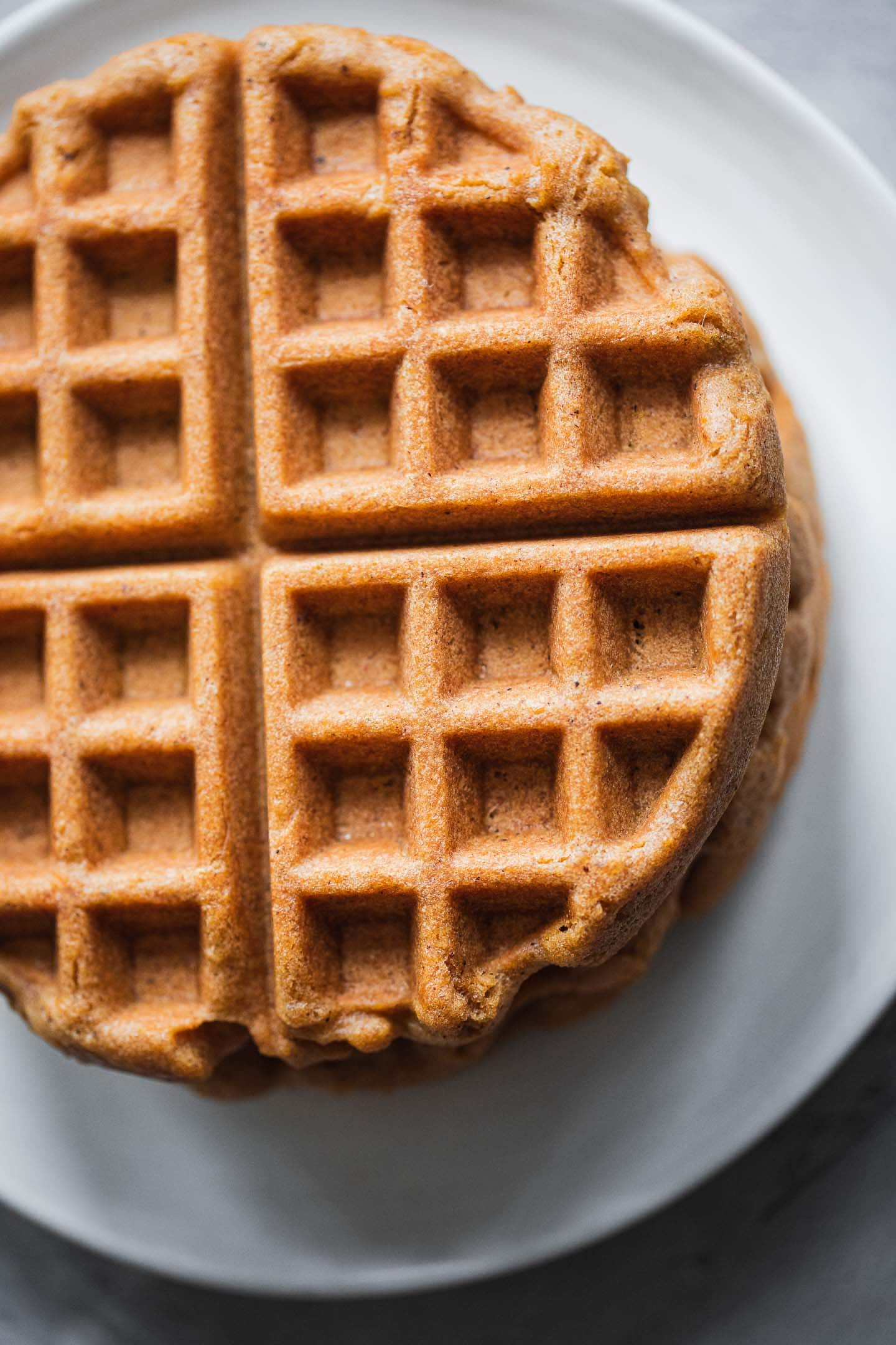 Stack of gluten-free waffles on a plate