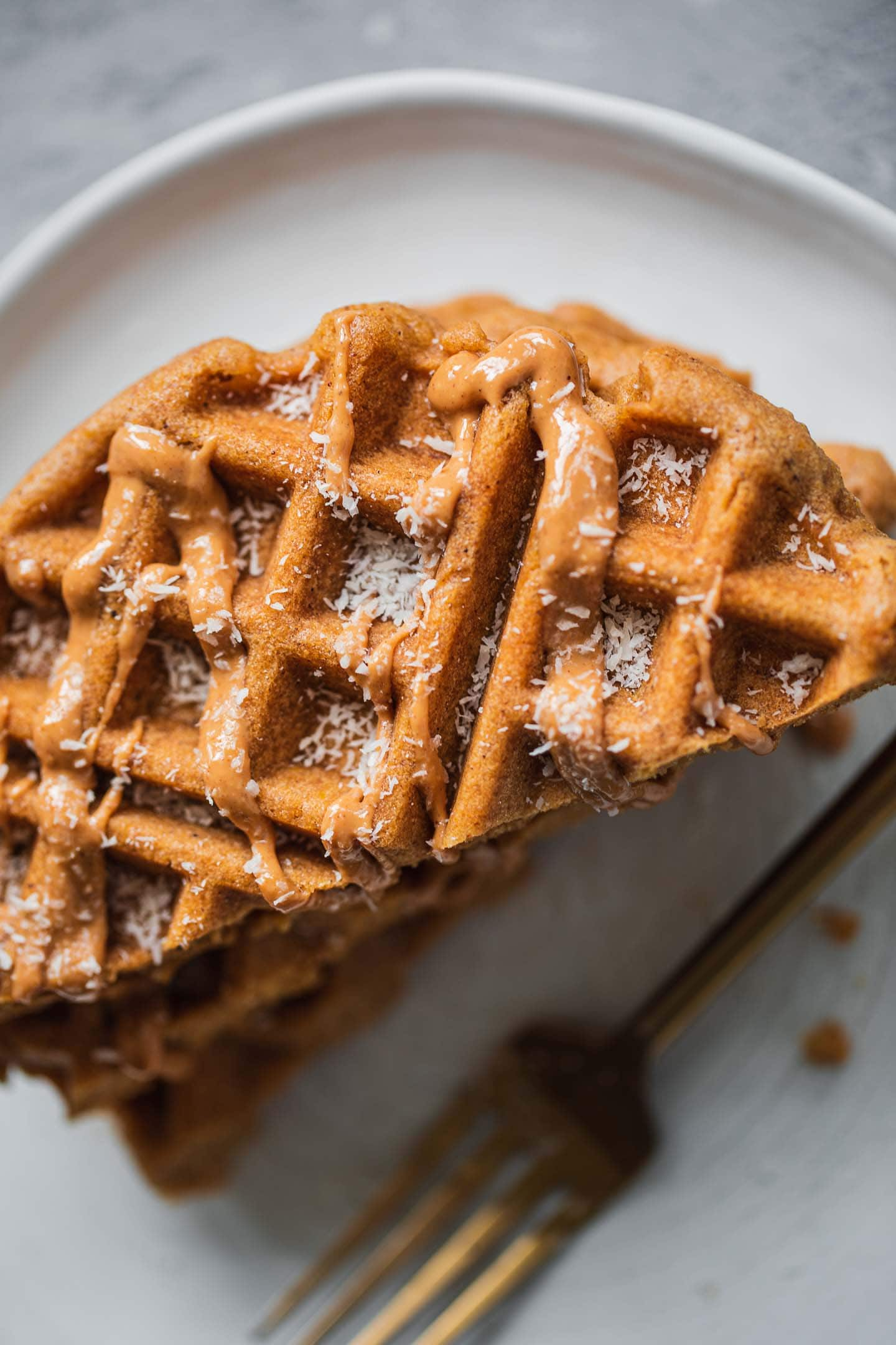 Stack of vegan gluten-free waffles on a plate