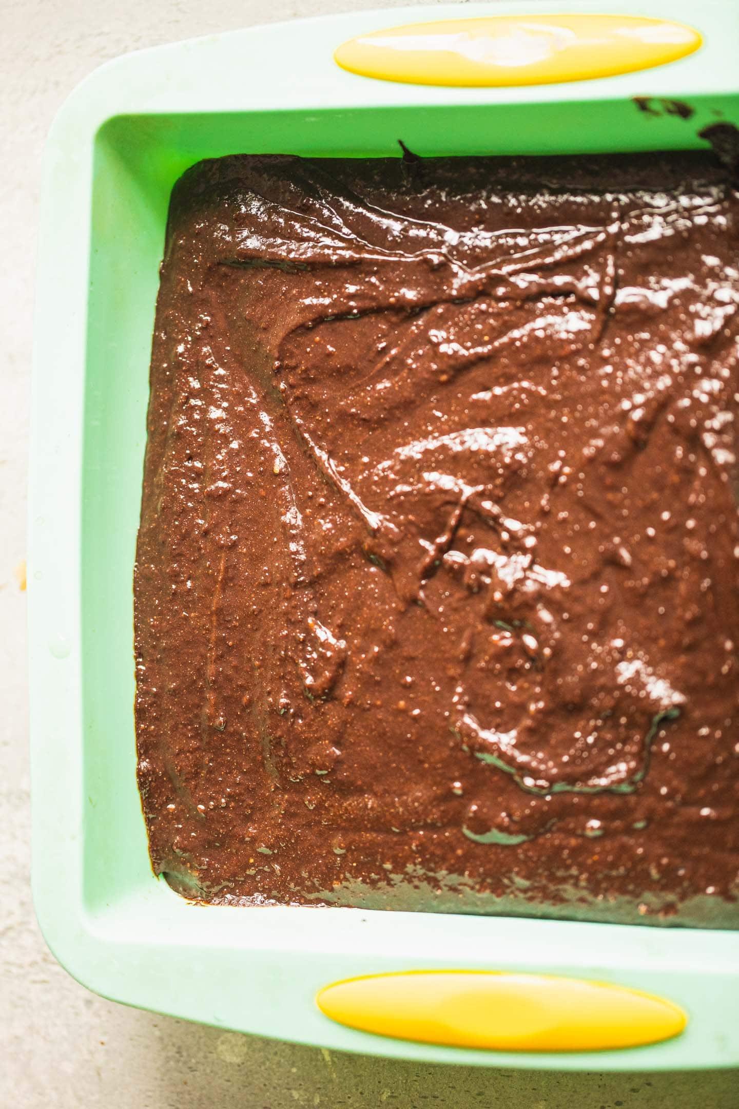 Vegan brownie batter in a baking tin