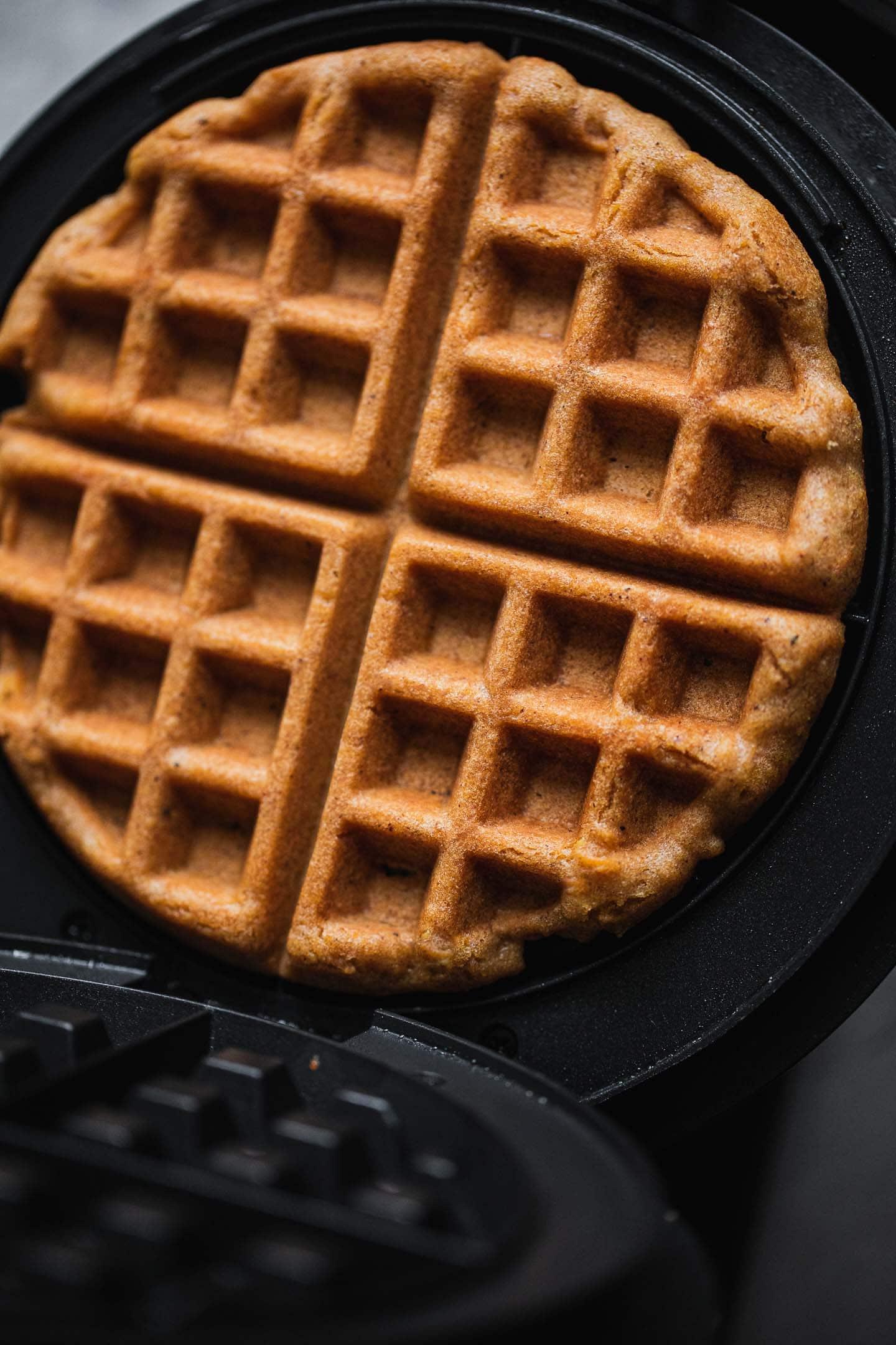 Vegan waffle in a waffle iron