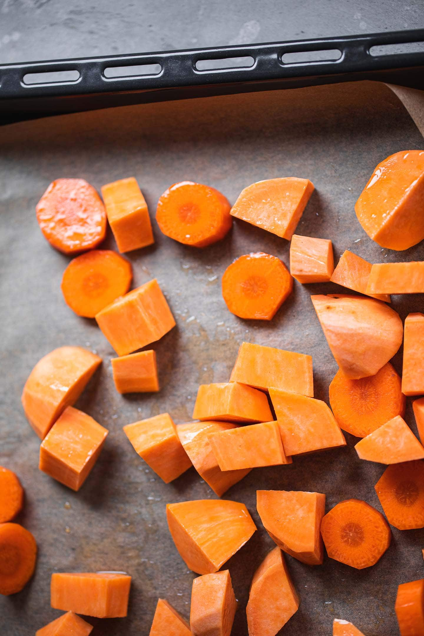 Carrot and sweet potato on a baking tray