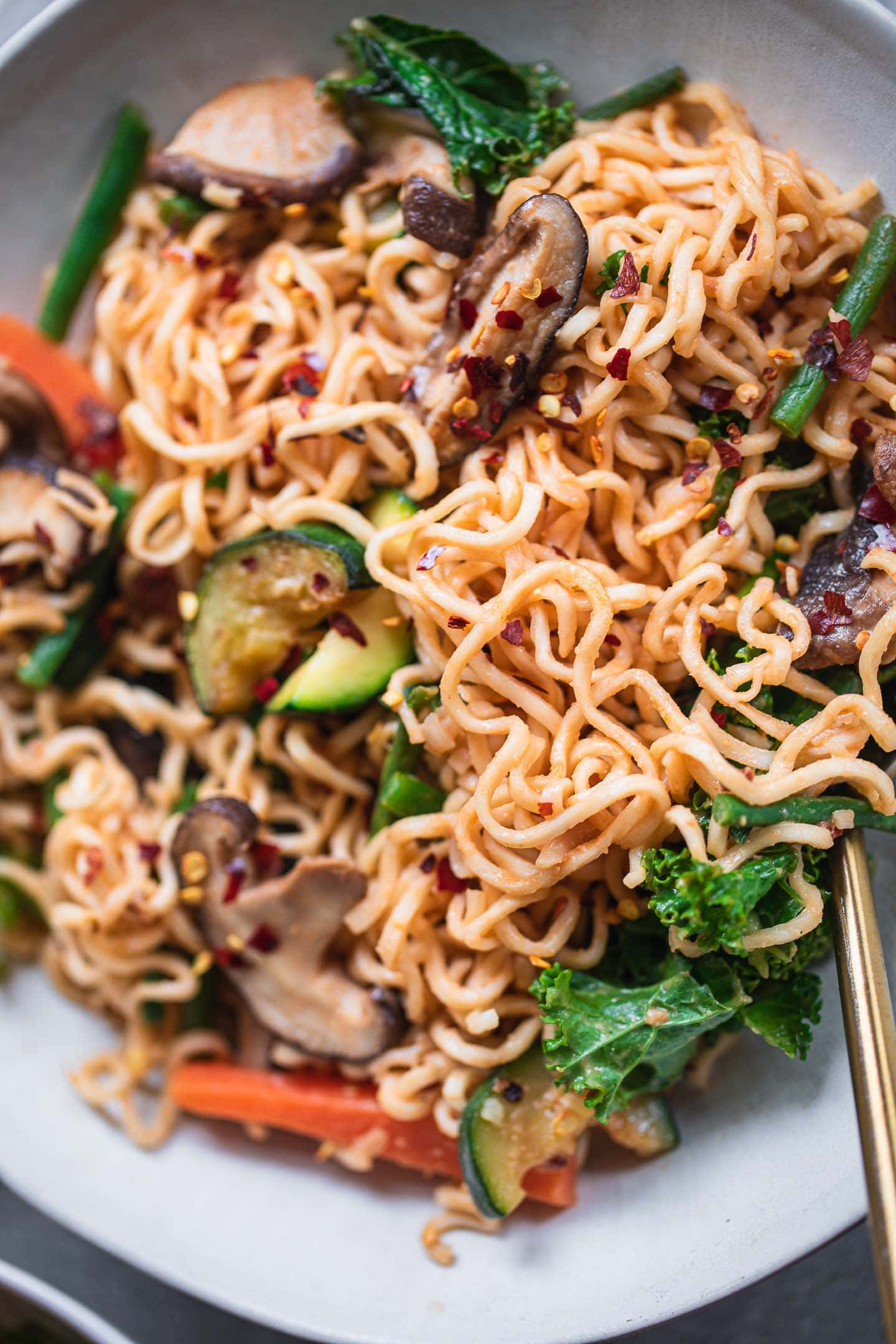 Closeup of peanut butter noodles with vegetables