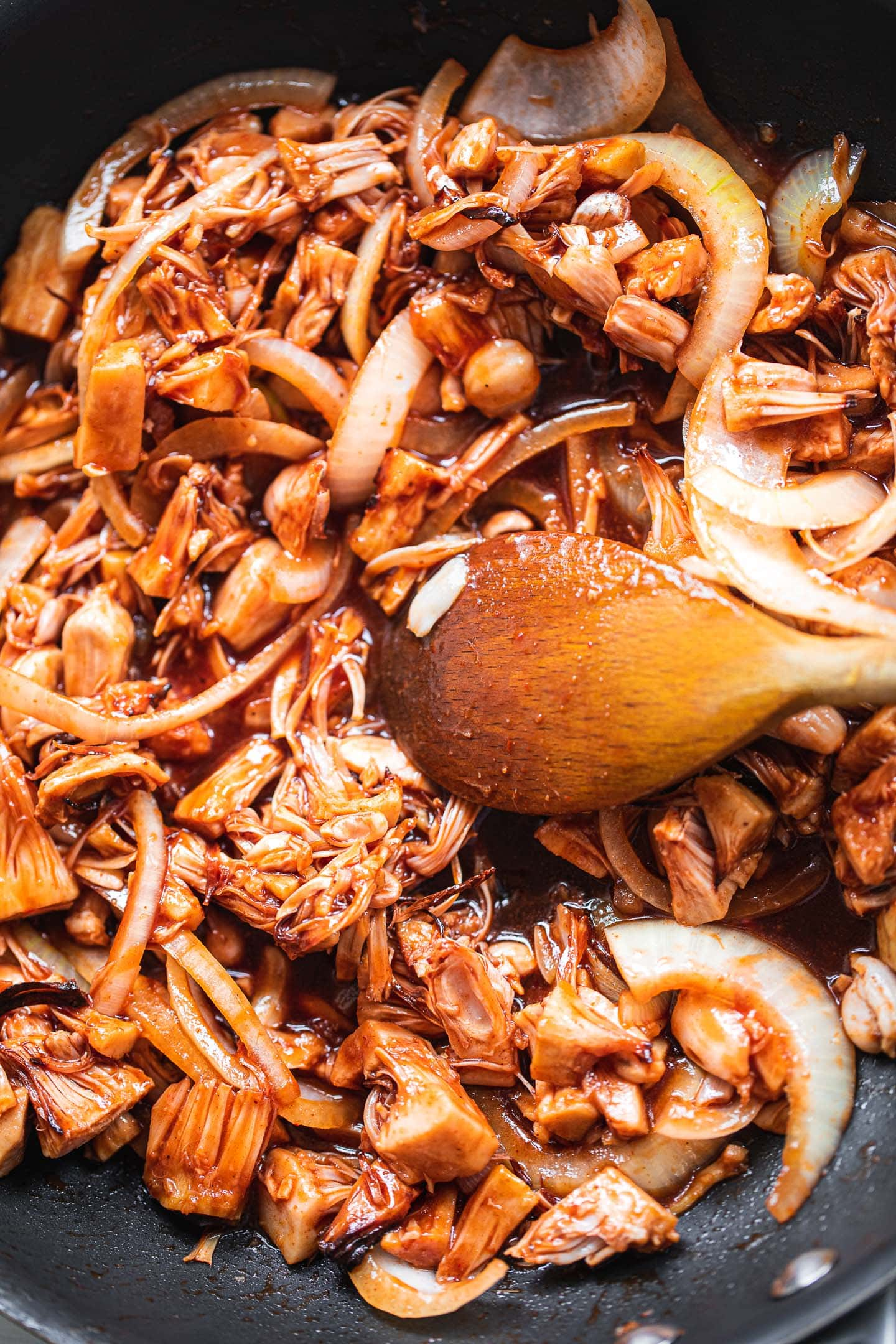 Jackfruit in a pan with a BBQ sauce