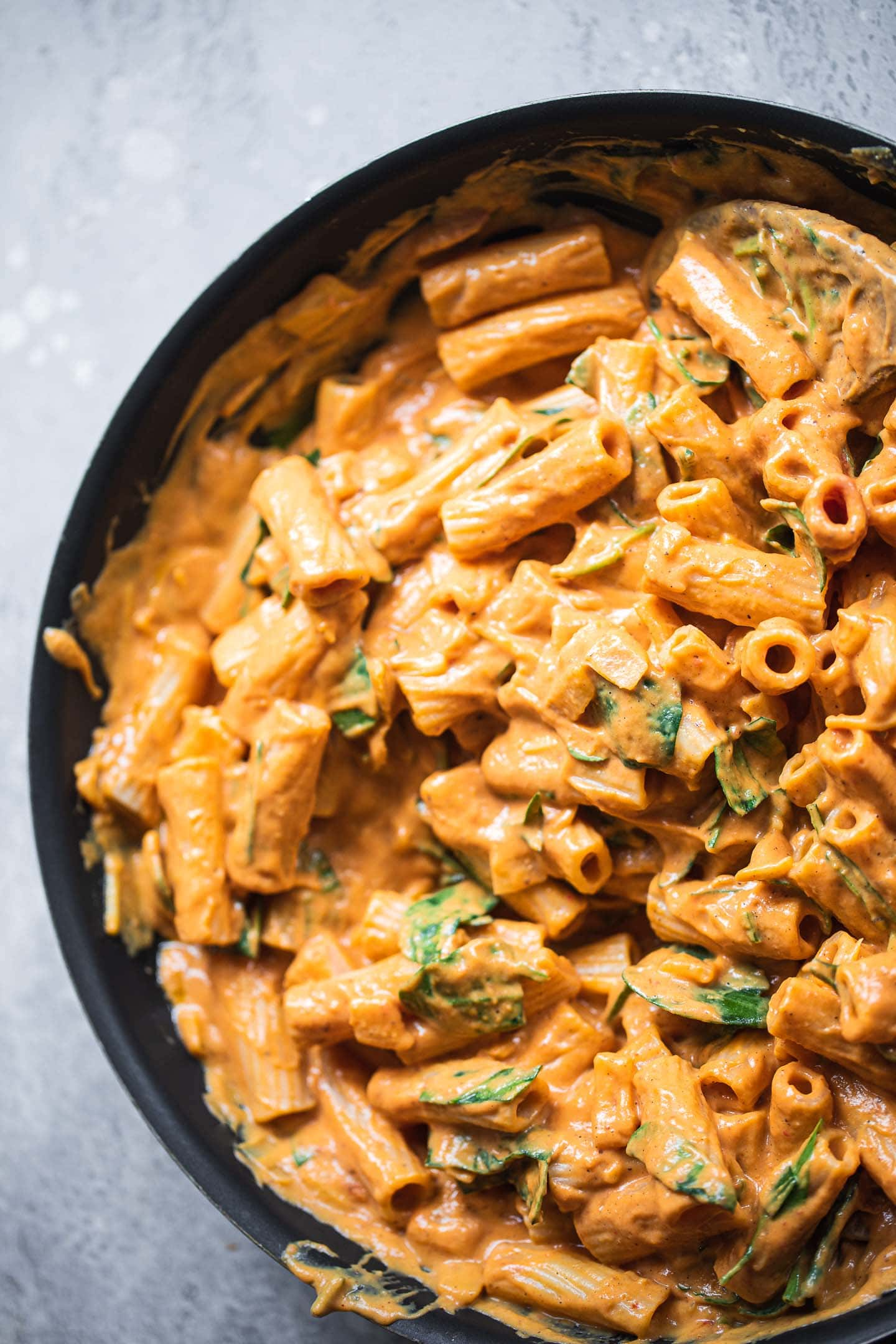 Pasta with a butternut squash and spinach in a pan