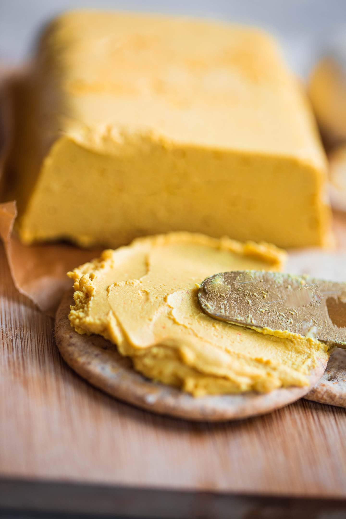 Spreadable vegan cheese on a cracker