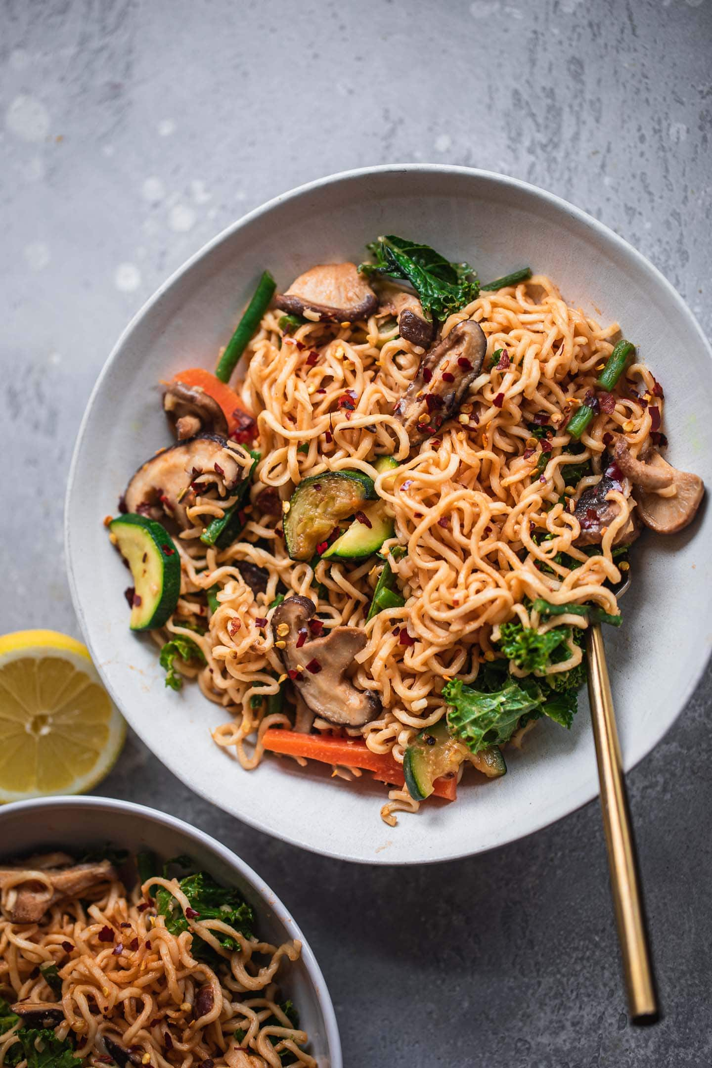 Two bowls of vegan noodles with vegetables