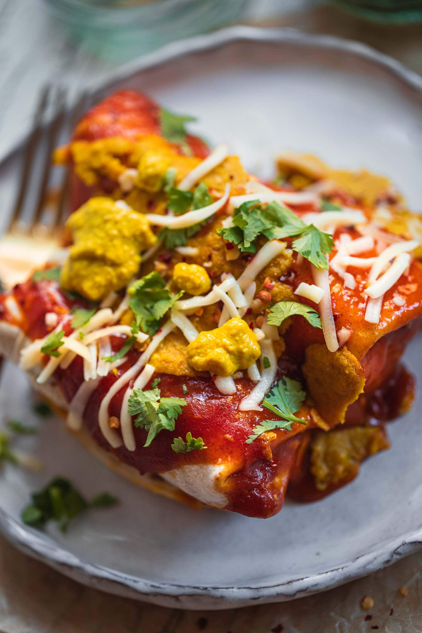 Vegan enchiladas with cashew cheese and fresh herbs