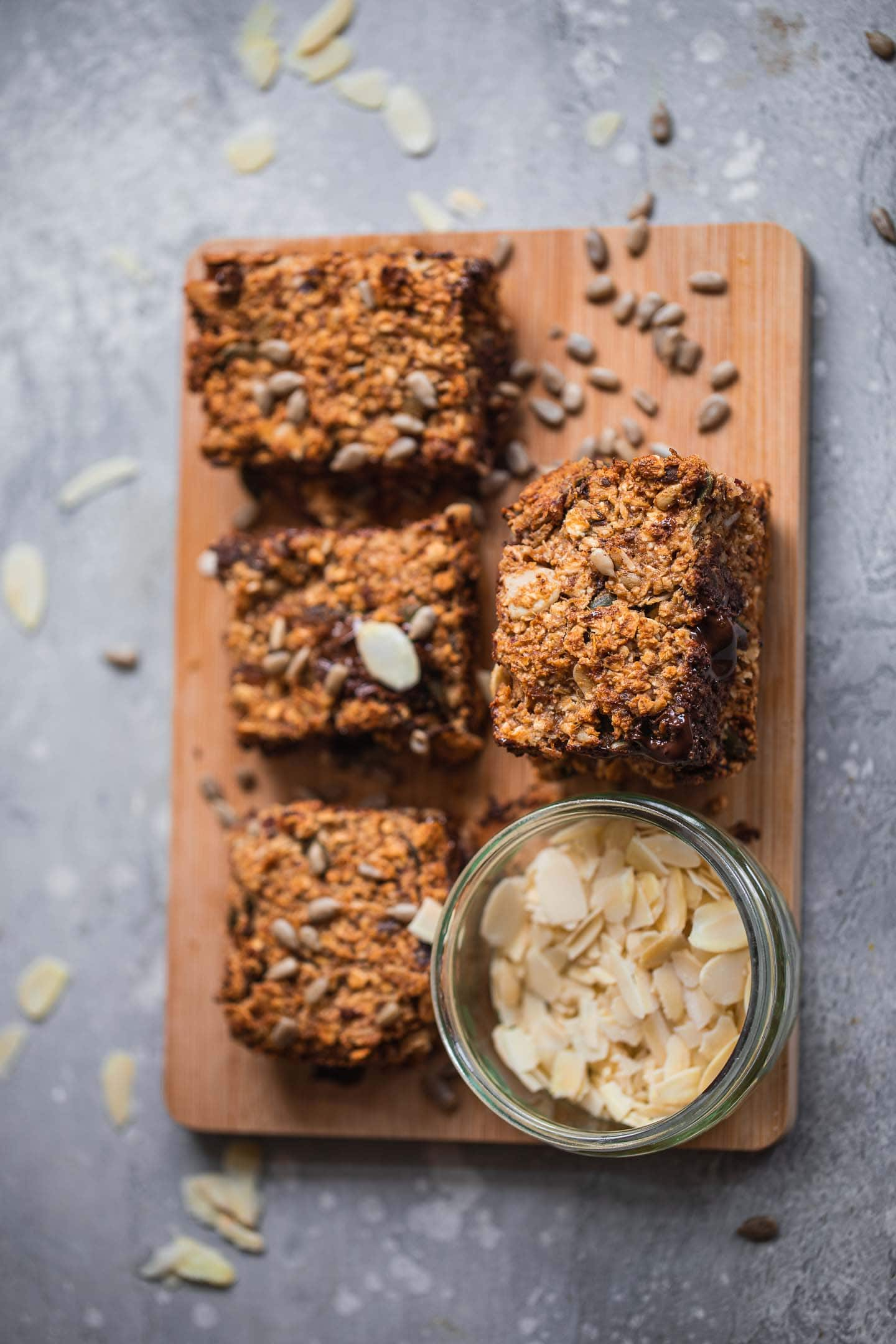 Vegan granola bars on a wooden board
