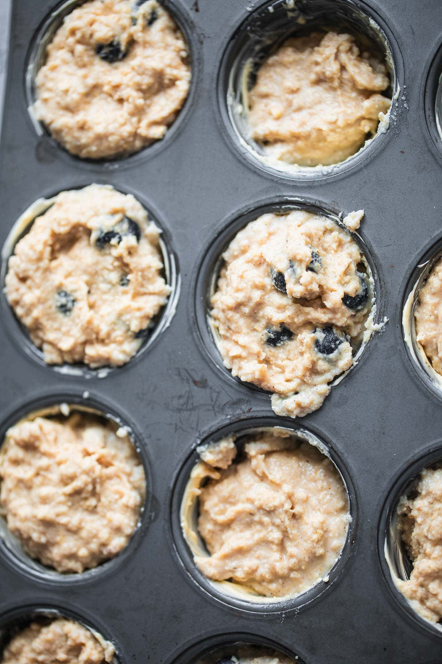 Vegan muffin dough in a baking tin