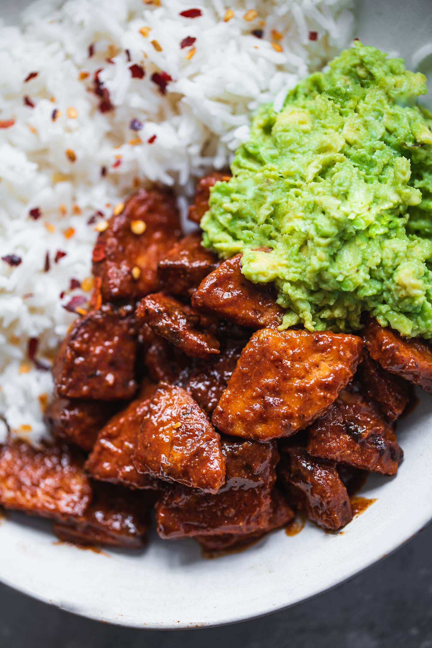 Vegan tempeh with BBQ sauce, avocado and rice