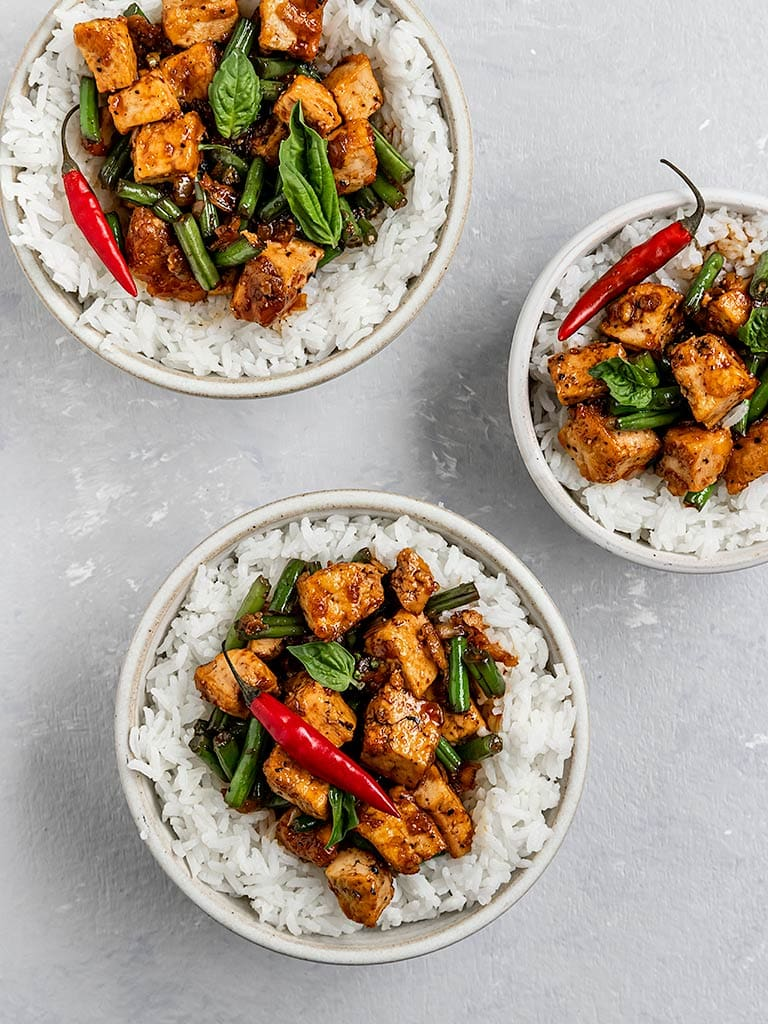 Black pepper tofu and green beans served with rice and red chillis