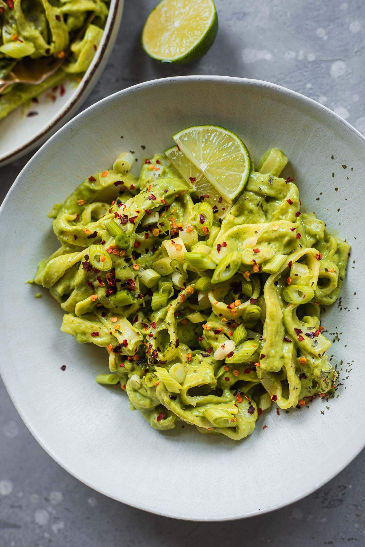 Bowl of avocado pasta with lime