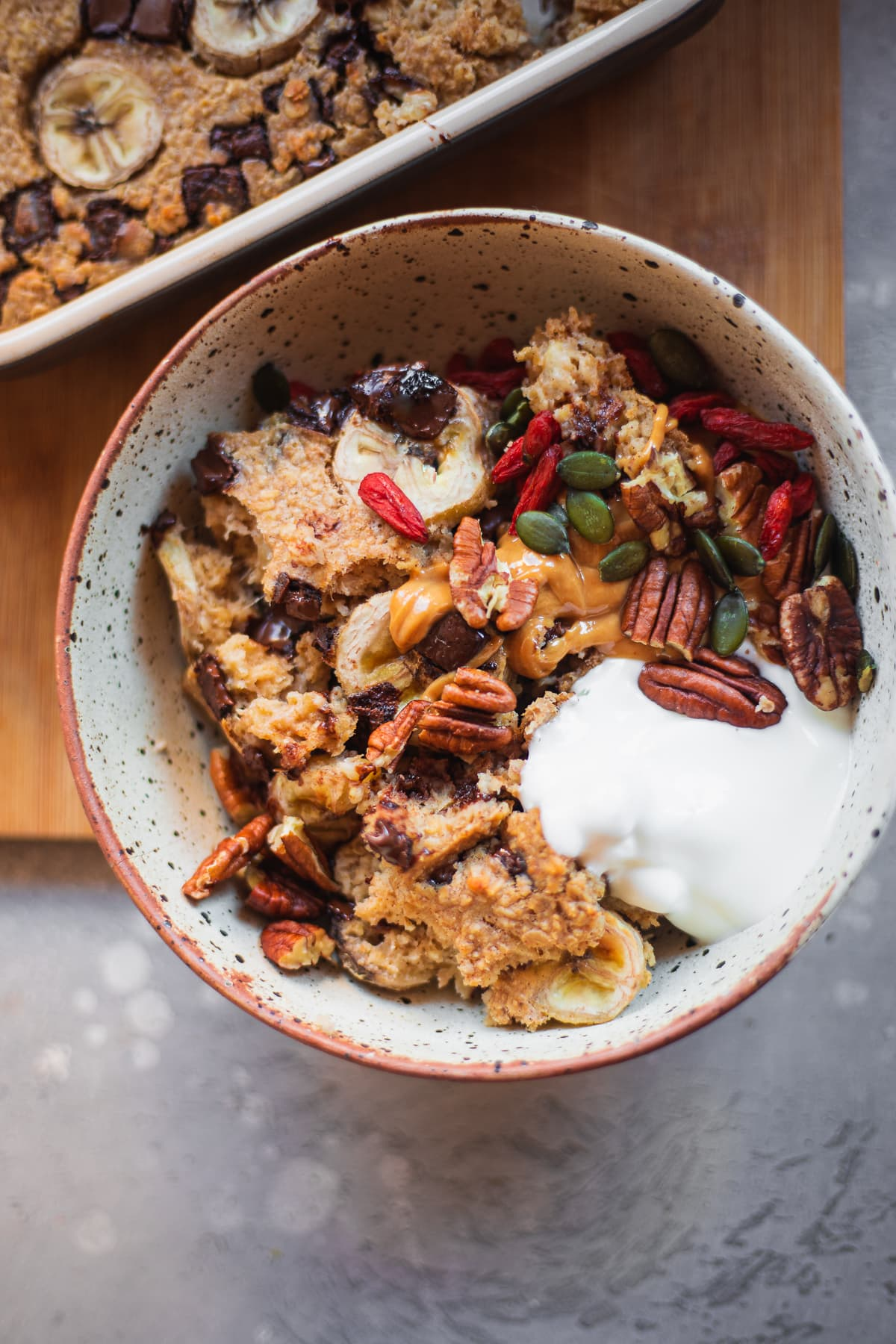 Bowl of banana bread baked oats with vegan yoghurt
