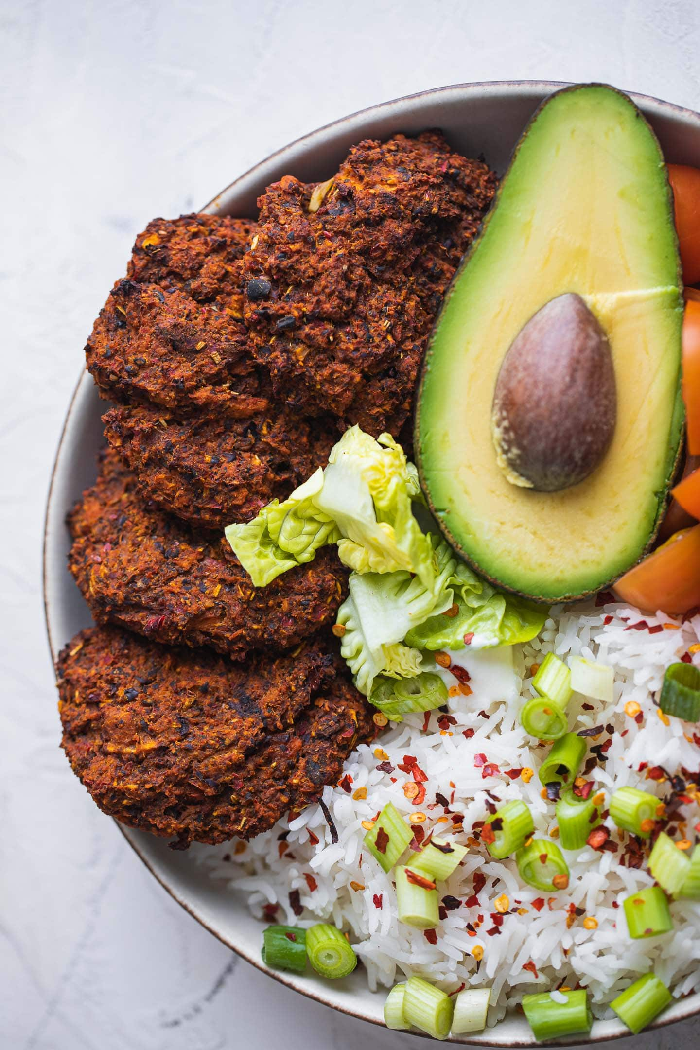 Bowl with black bean burgers, rice and avocado