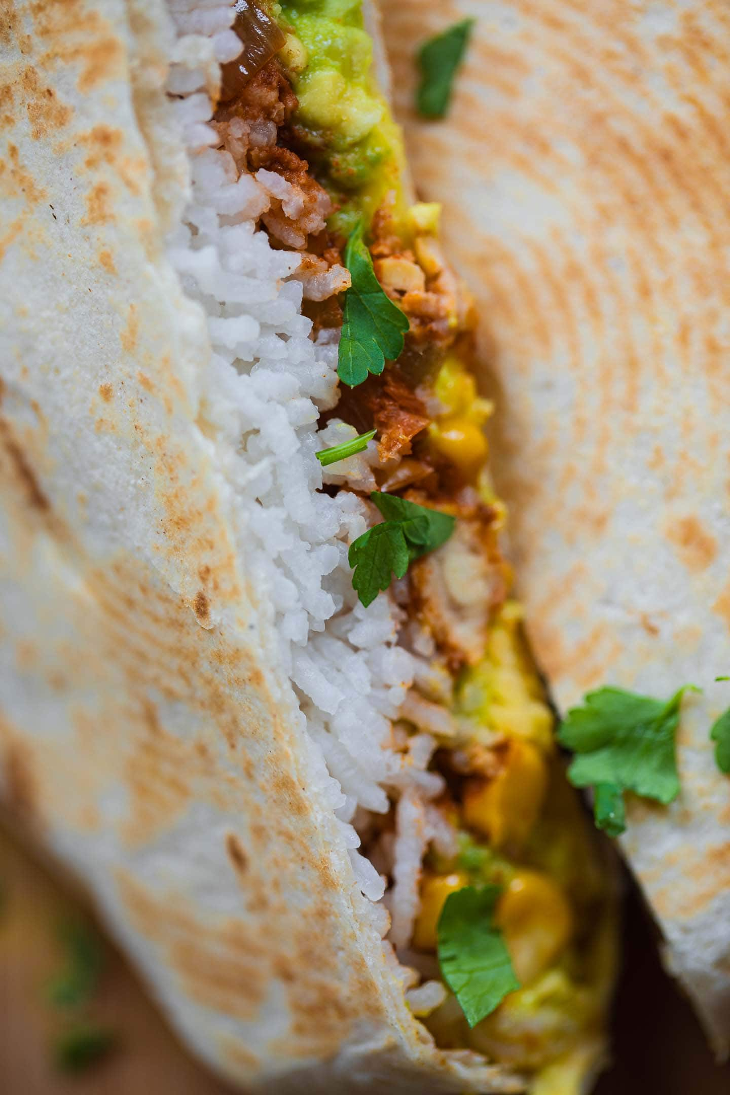 Closeup of a Crunchwrap with tempeh and rice