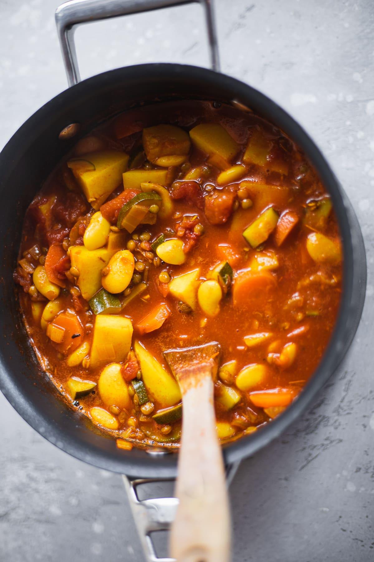 Saucepan with potato and lentil soup