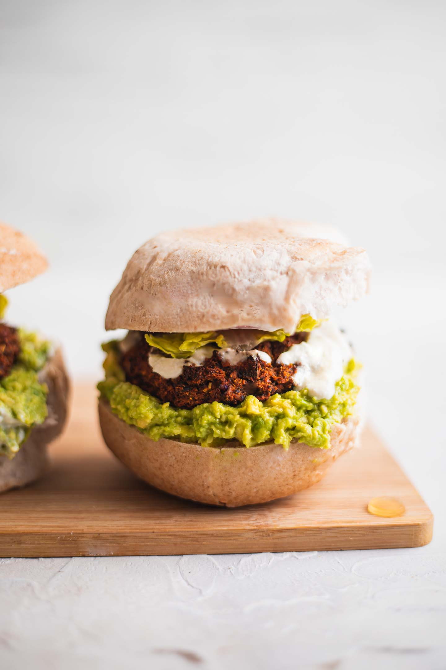Vegan burger with avocado and lettuce