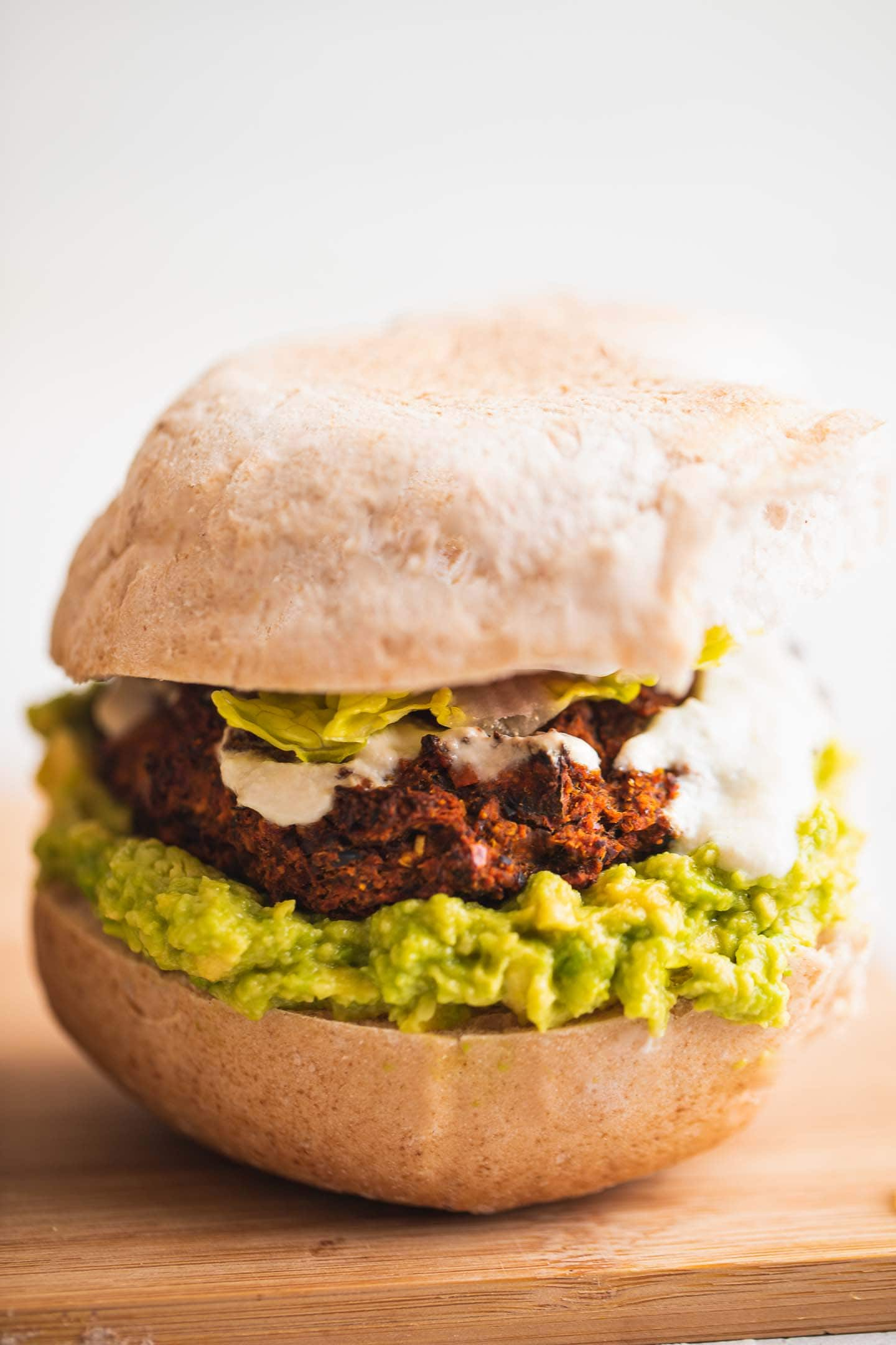 Vegan burger with avocado and vegetables