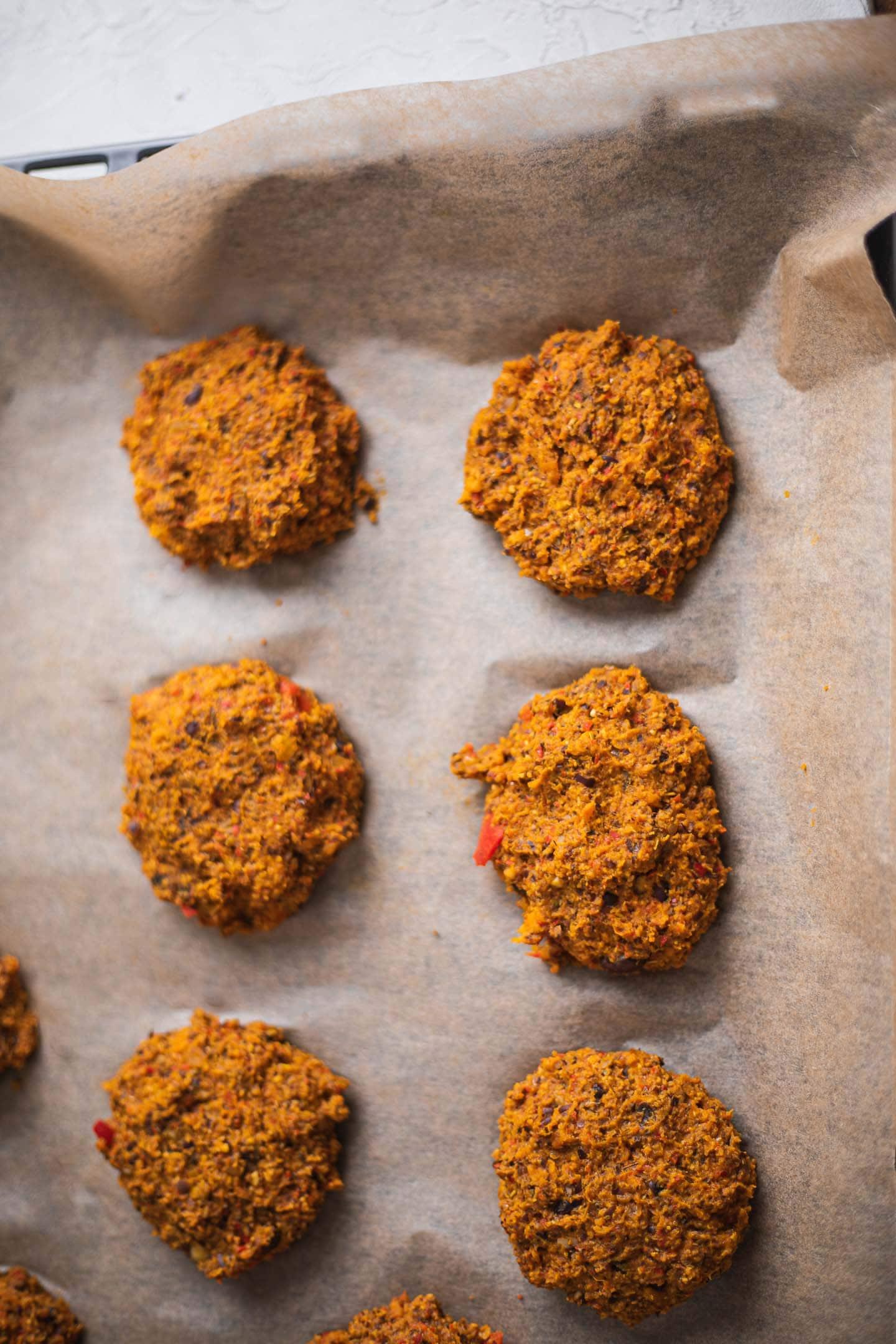 Vegan burgers on a baking tray