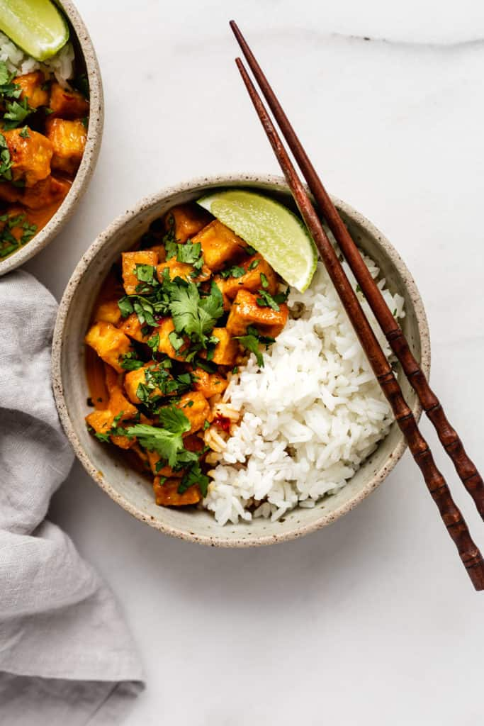 Thai red coconut curry with tofu served with rice, lime and corriander