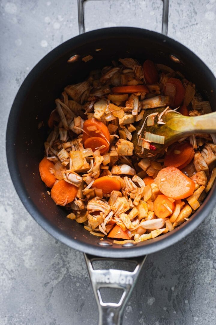 Carrots, jackfruit and spices in a saucepan